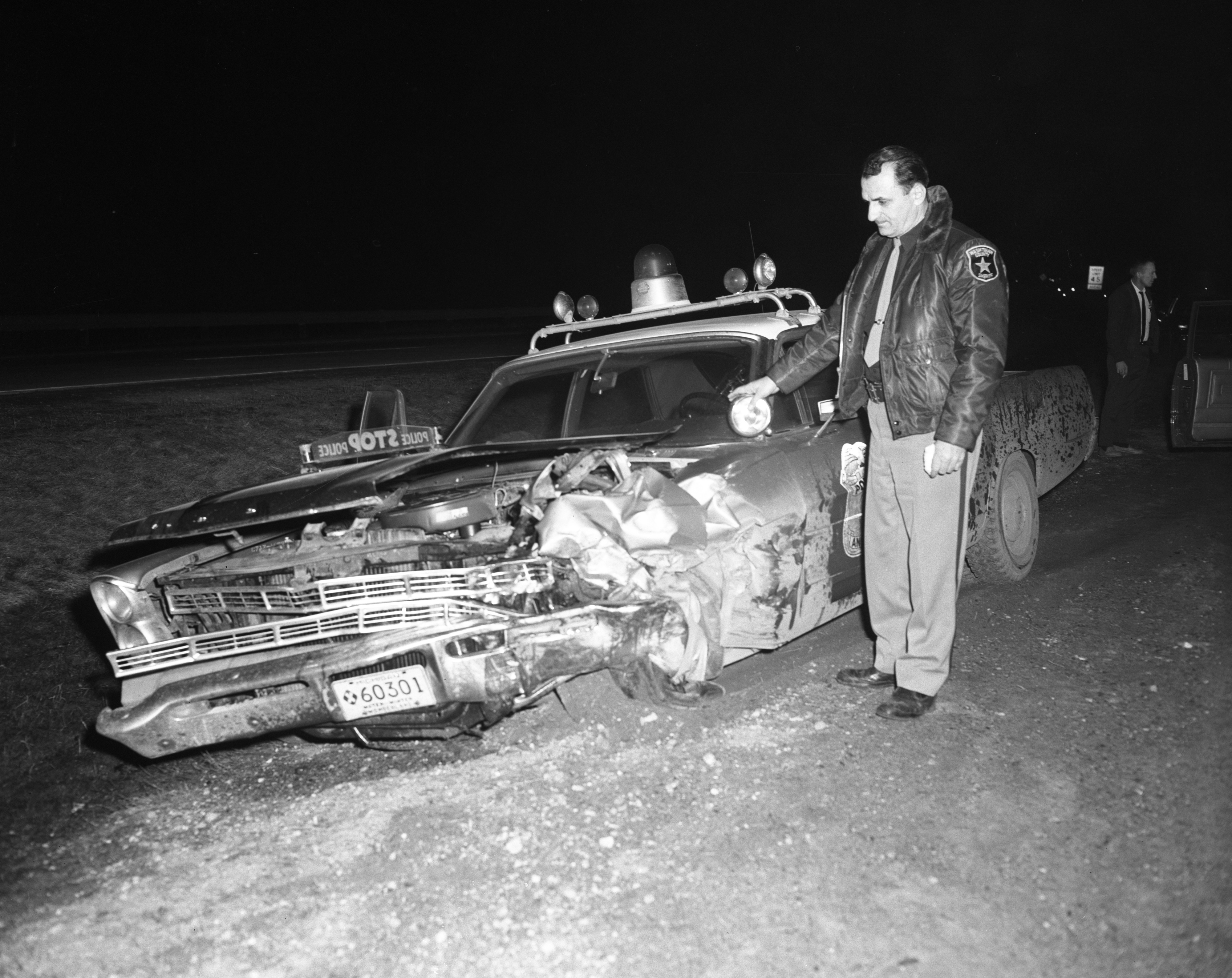 Sheriff's Squad Car Wrecked Assisting Ann Arbor Police In Robbery Chase, March 1967 image