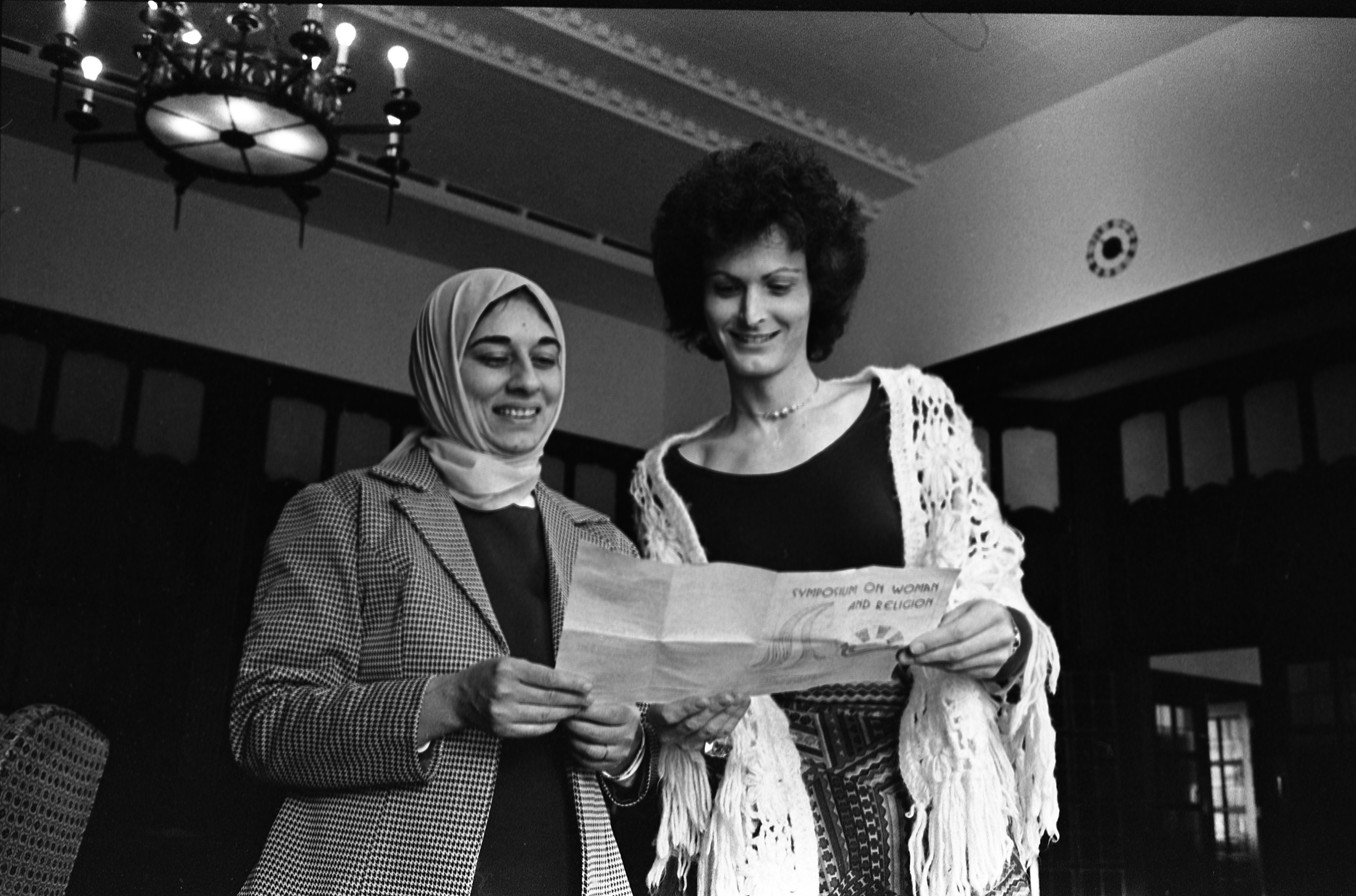 Participants Of The Jewish/Arabic Religious Conference Looking Over Program Guide, March 1975 image