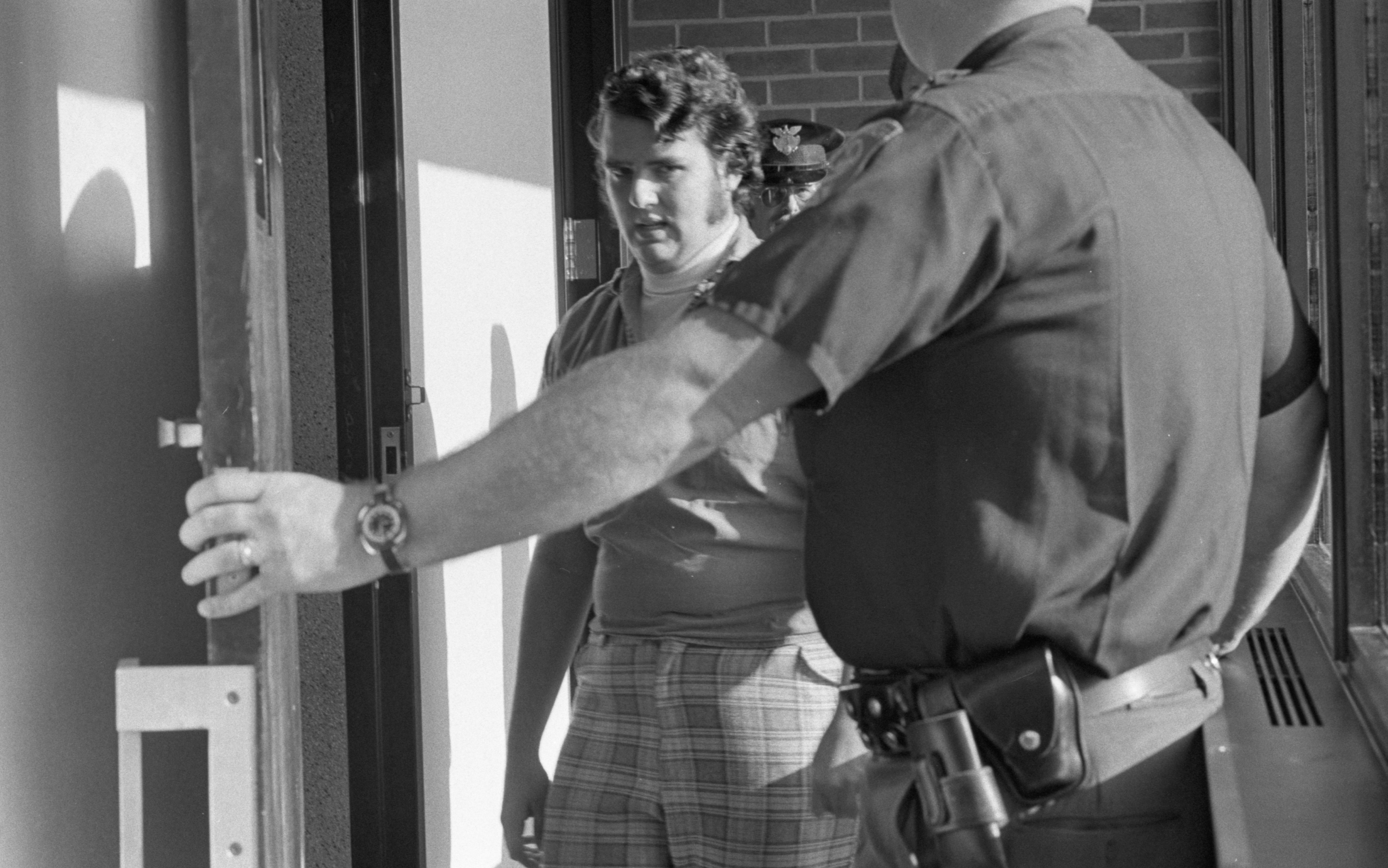 Charles Duty, Bank Robbery Suspect, Entering Jail Cell, August 1975 image