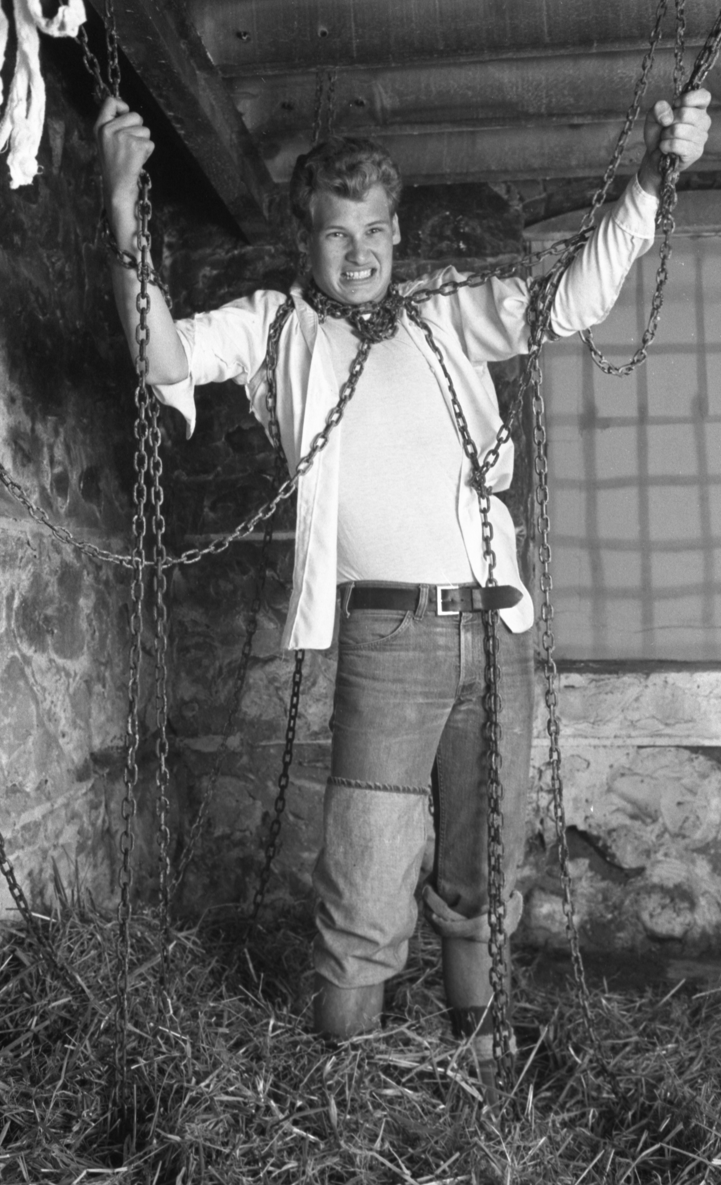 Neil Sendler Is Bound By Chains At The ROTC Spook House, October 1975 image
