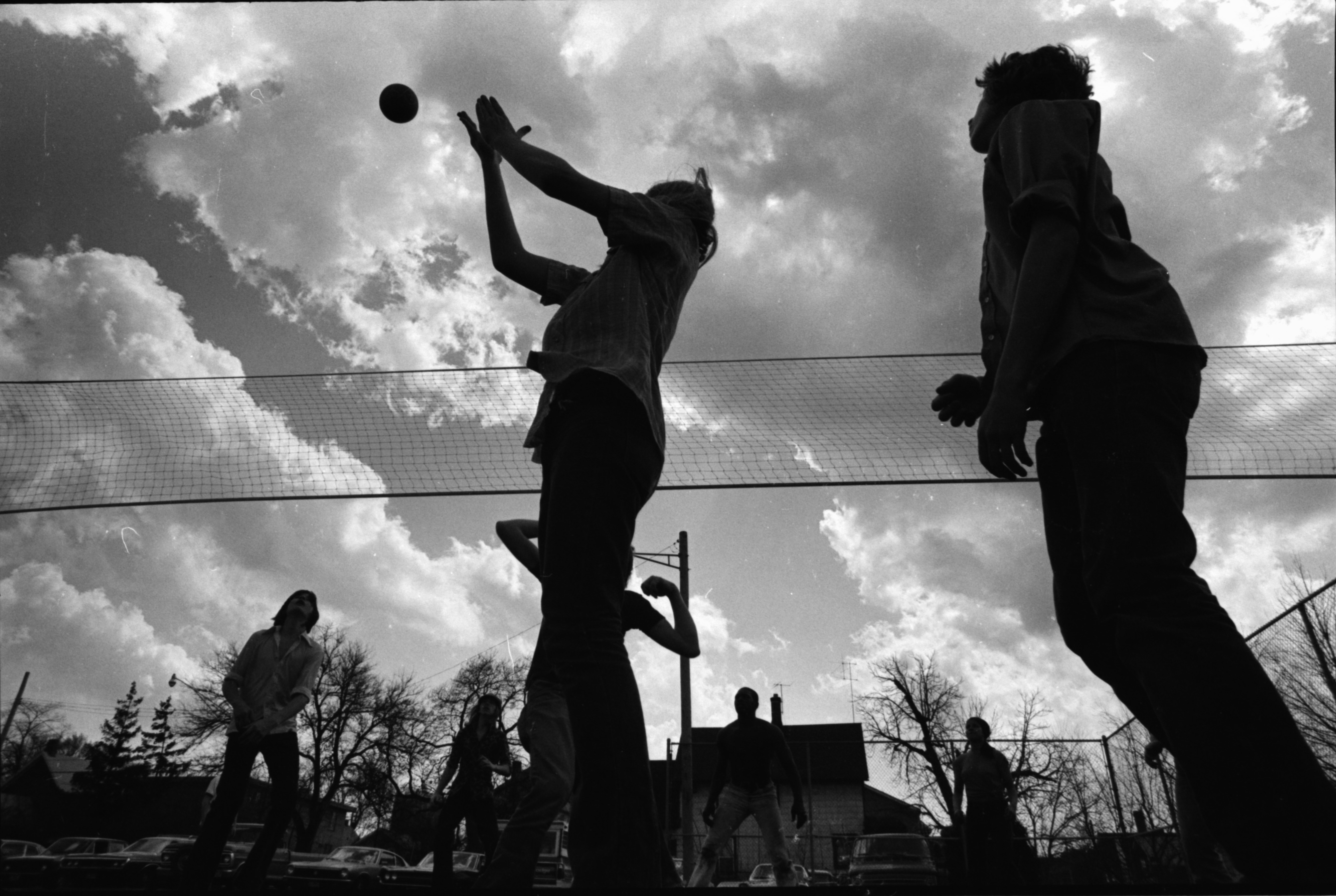 Students Play Volleyball at Community High School, April 1976 image