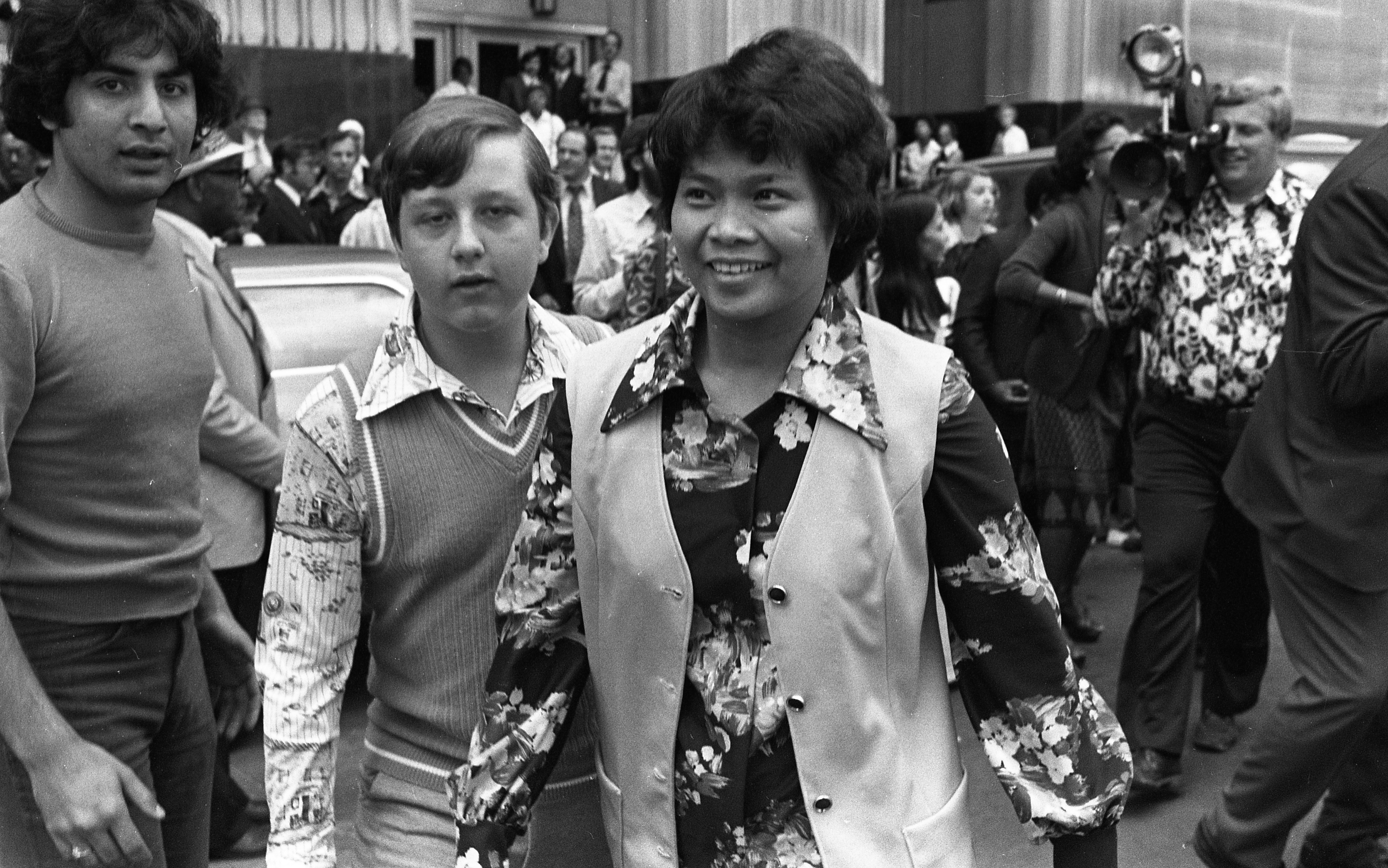 Filipina B. Narciso Leaving The Federal Building In Detroit With Todd Branham, After Preliminary VA Hearings, July 1976 image