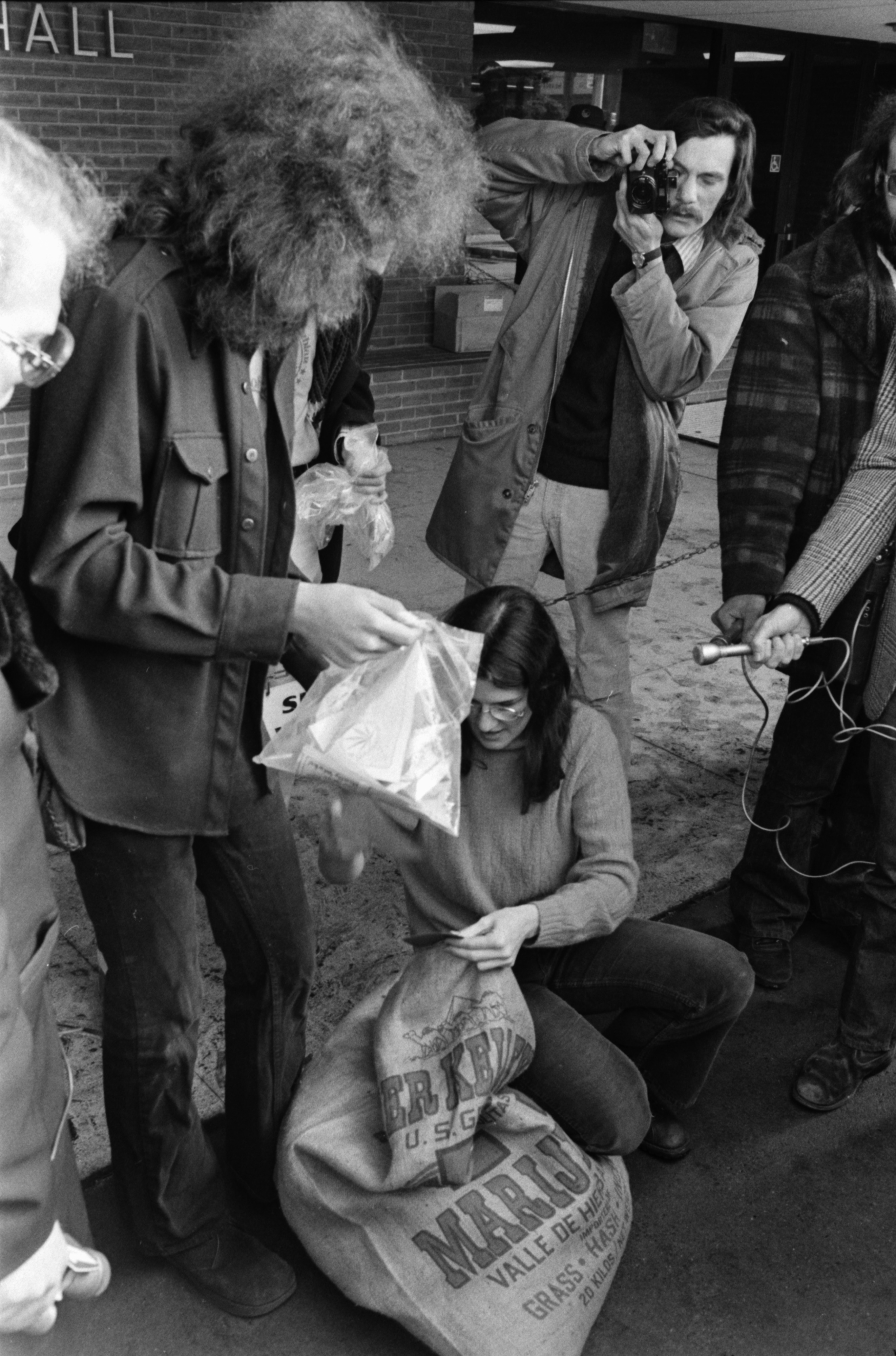 County Commissioner Catherine McClary Reaches into Sack at Drawing for Free Pot Giveaway, Ann Arbor City Hall, January 1975 image