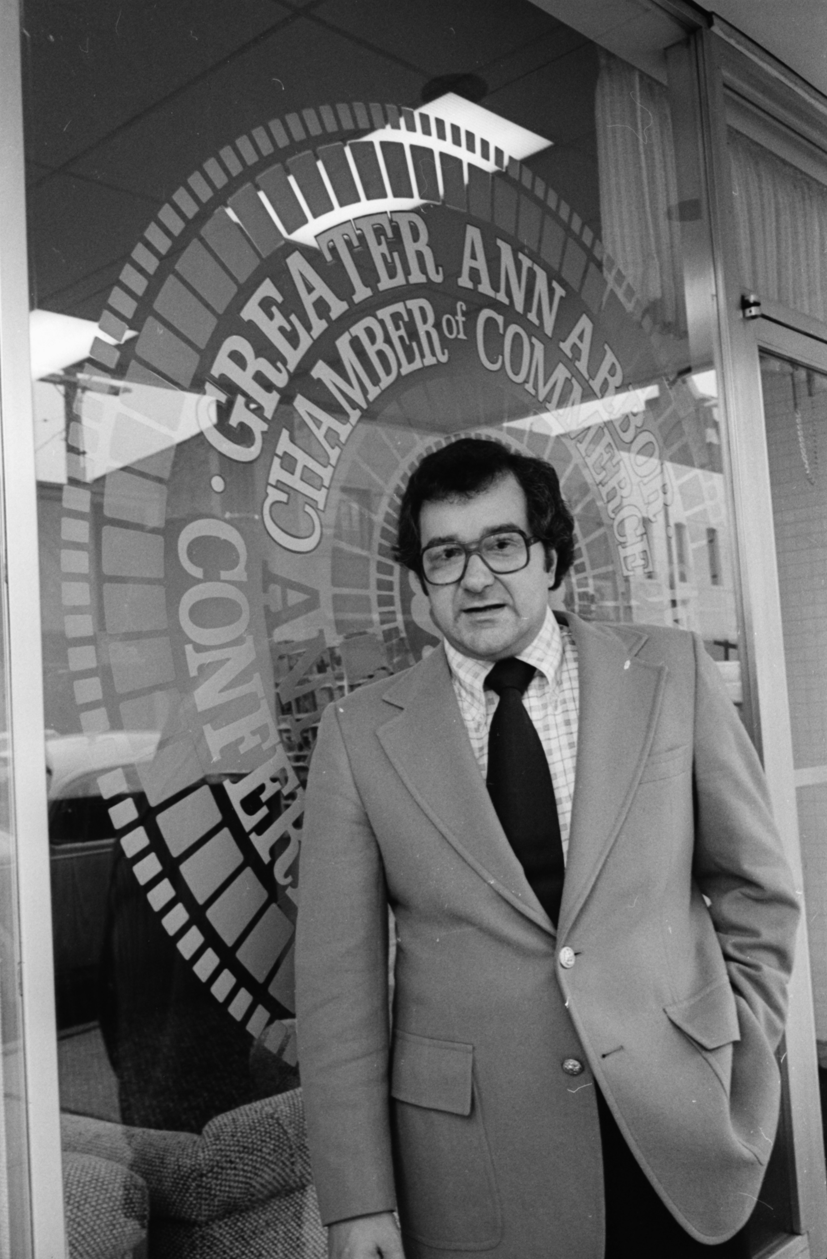 James Frenza, Executive Director of the Ann Arbor Chamber of Commerce, in Front of The Chamber of Commerce, September 1977 image