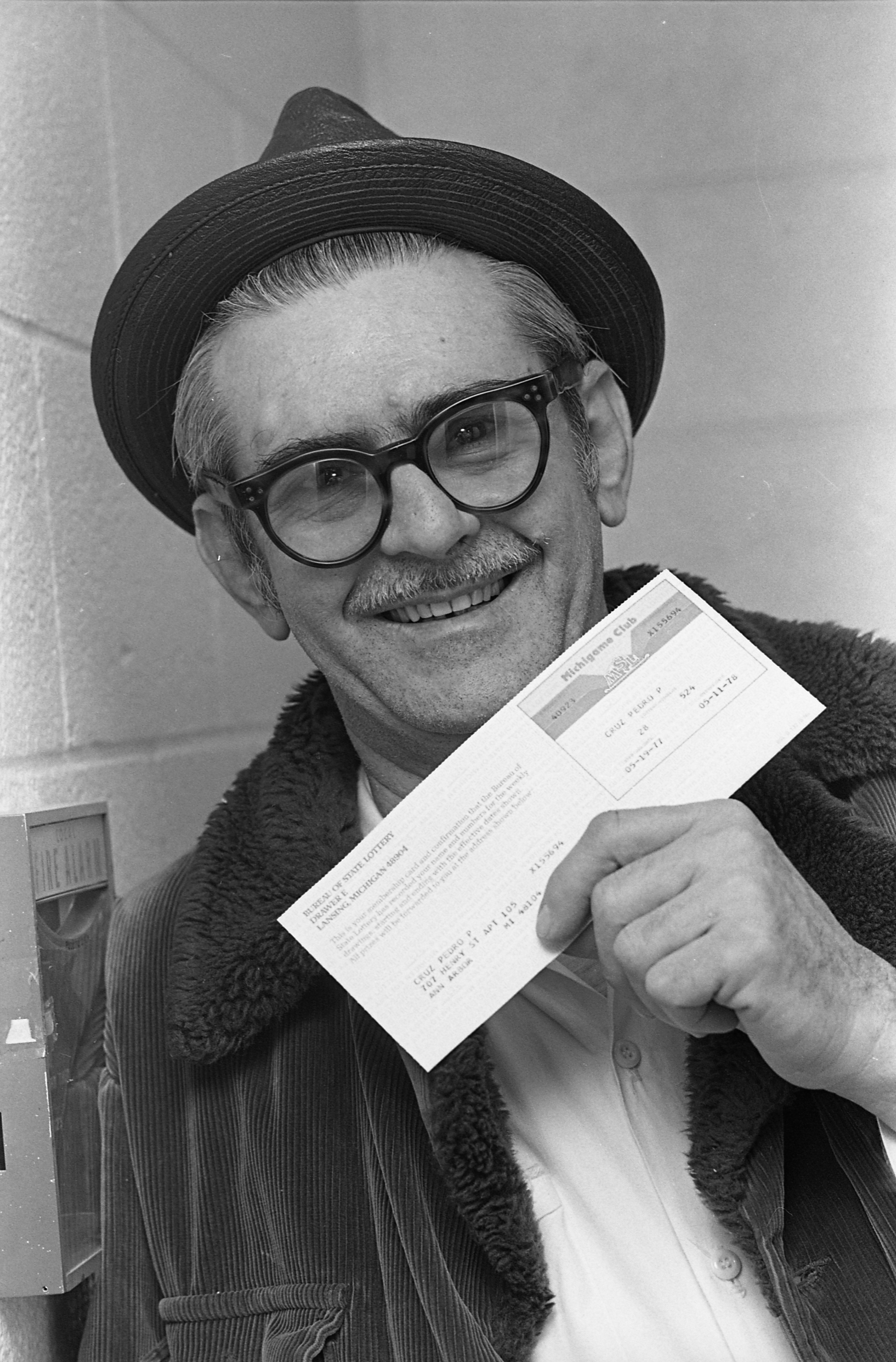 Pedro Cruz Shows Off Lottery Card That Gives Him A Chance To Win Millions, January 6, 1978 image