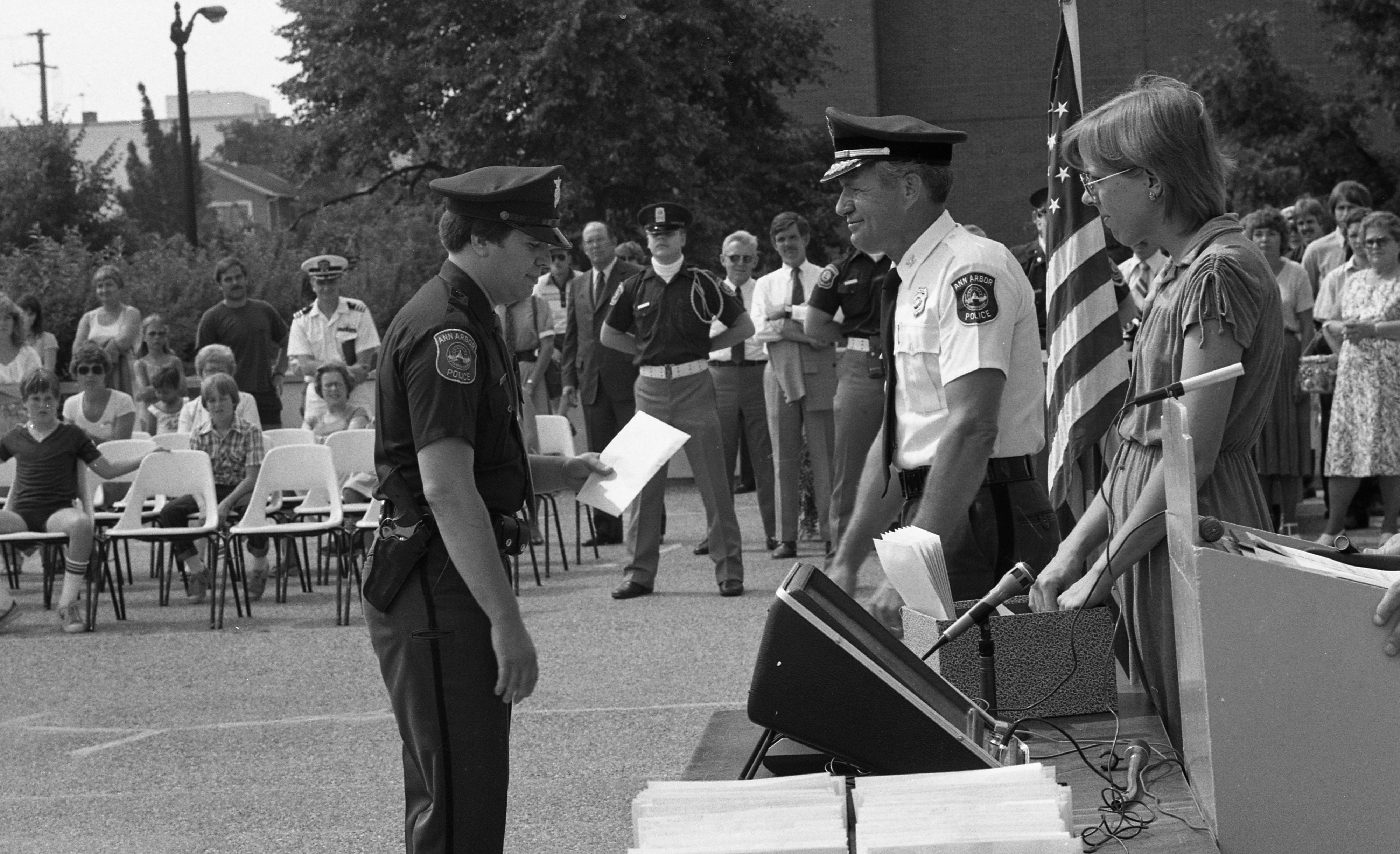 Ann Arbor Police Chief William J. Corbett Presents  Award to Officer, July 1981 image