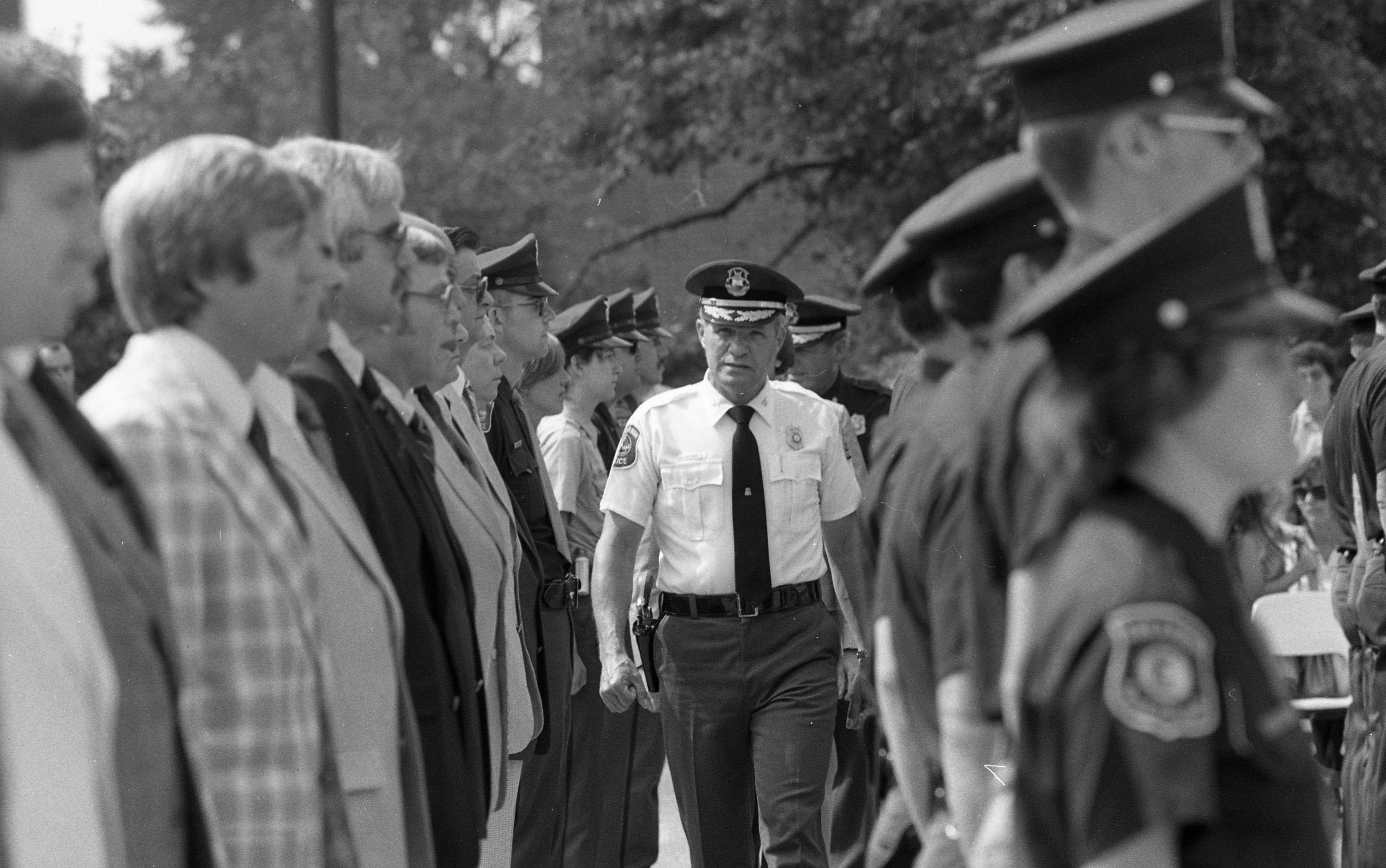 Ann Arbor Police Chief William J. Corbett Reviews Officers at Awards Ceremony, July 1981 image
