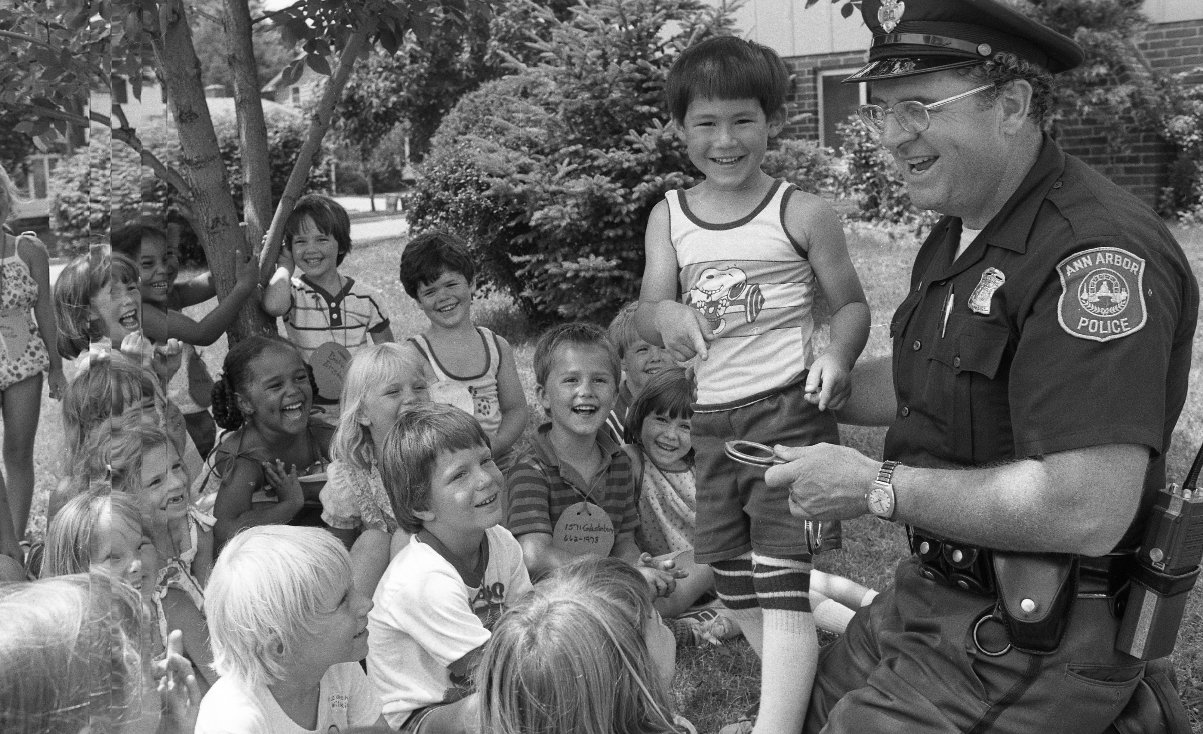 Ann Arbor Police Patrolman Patrick Nolan a Big Hit at Safety Town, July 1982 image