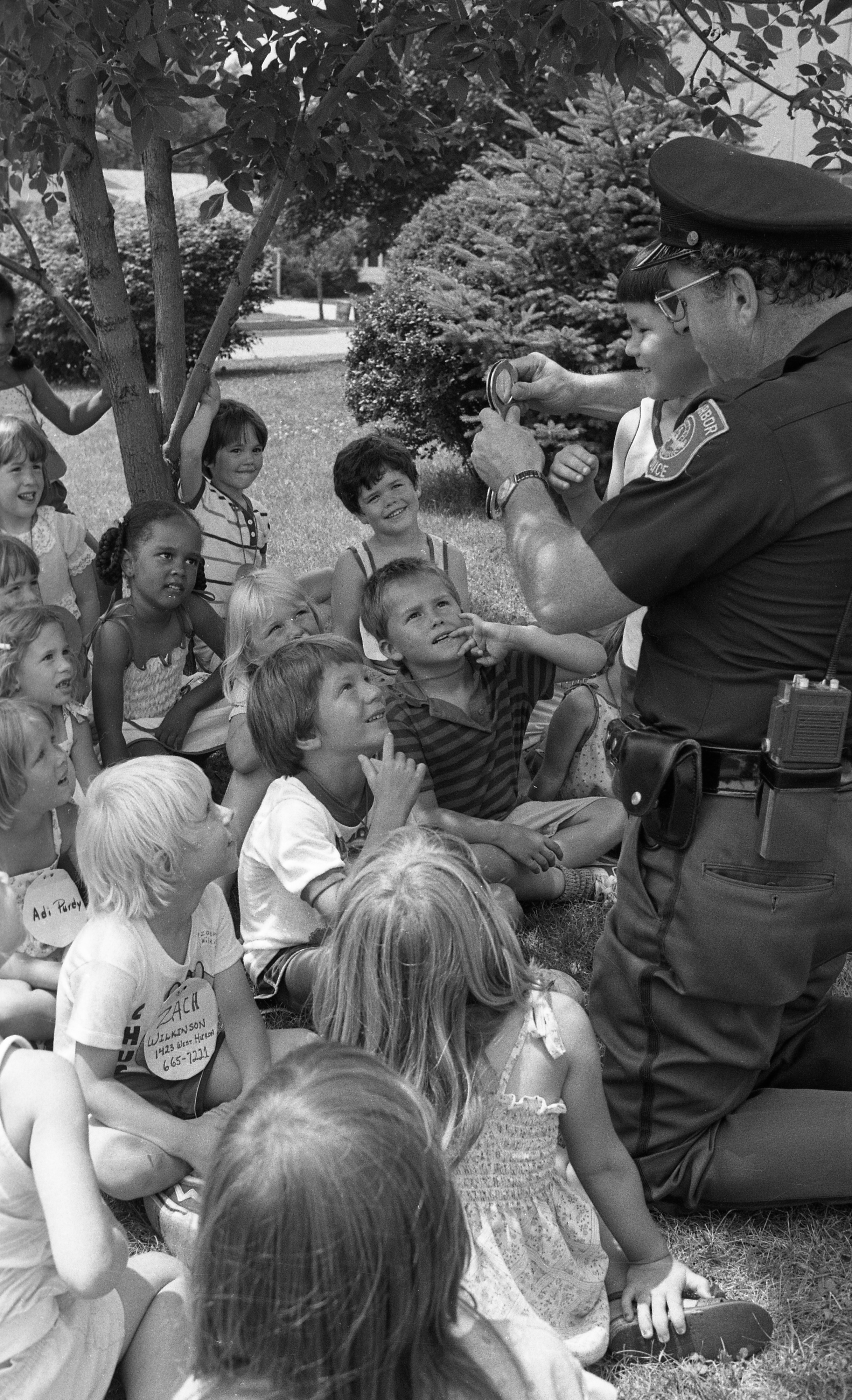 Ann Arbor Police Officer James Patrick Nolan Demonstrates Handcuffs at Safety Town, July 1982 image