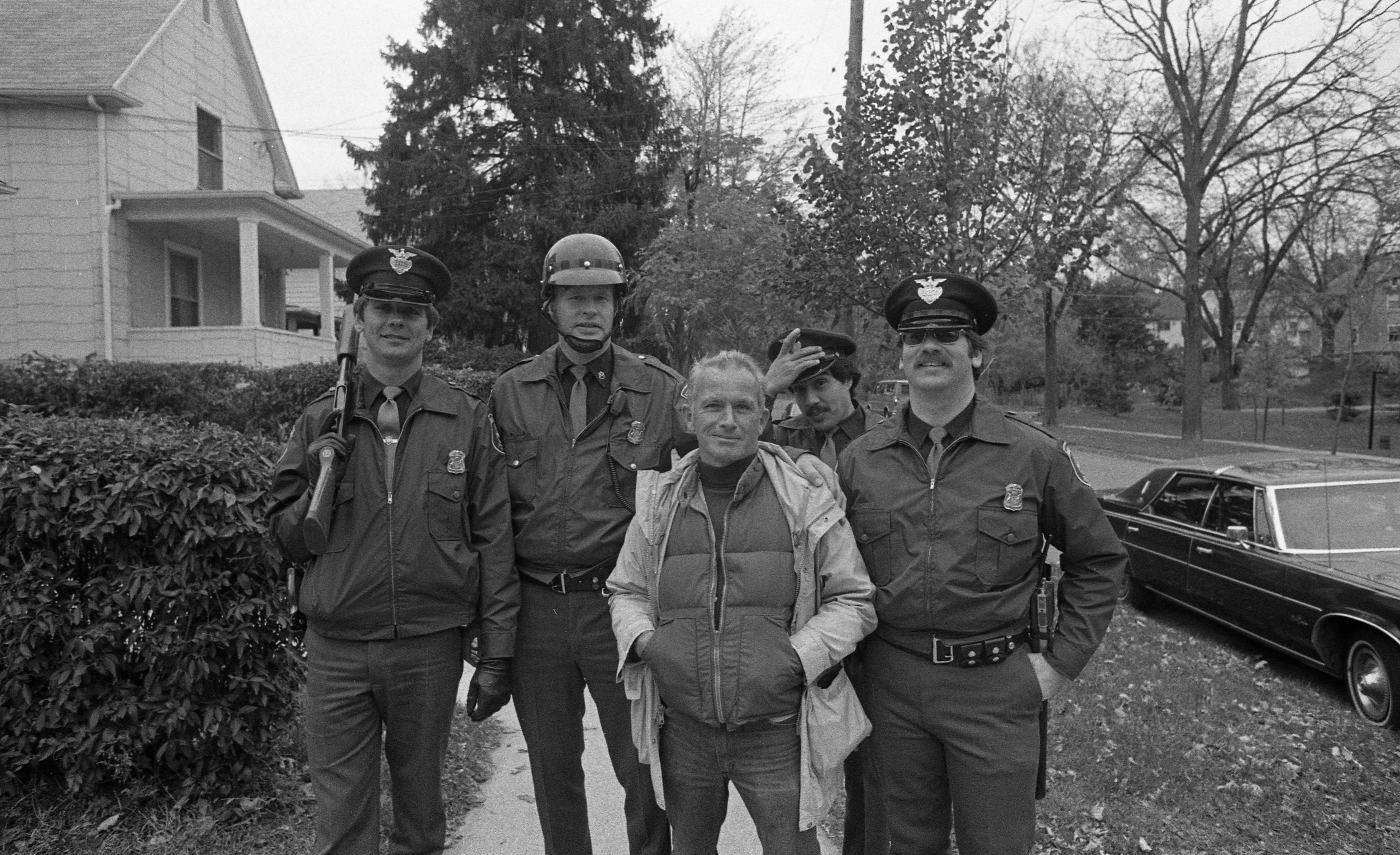 Ann Arbor Police and Ann Arbor News Photographer Jack Stubbs During Search for Escaped Murderer Kyle Johnson, October 1982 image