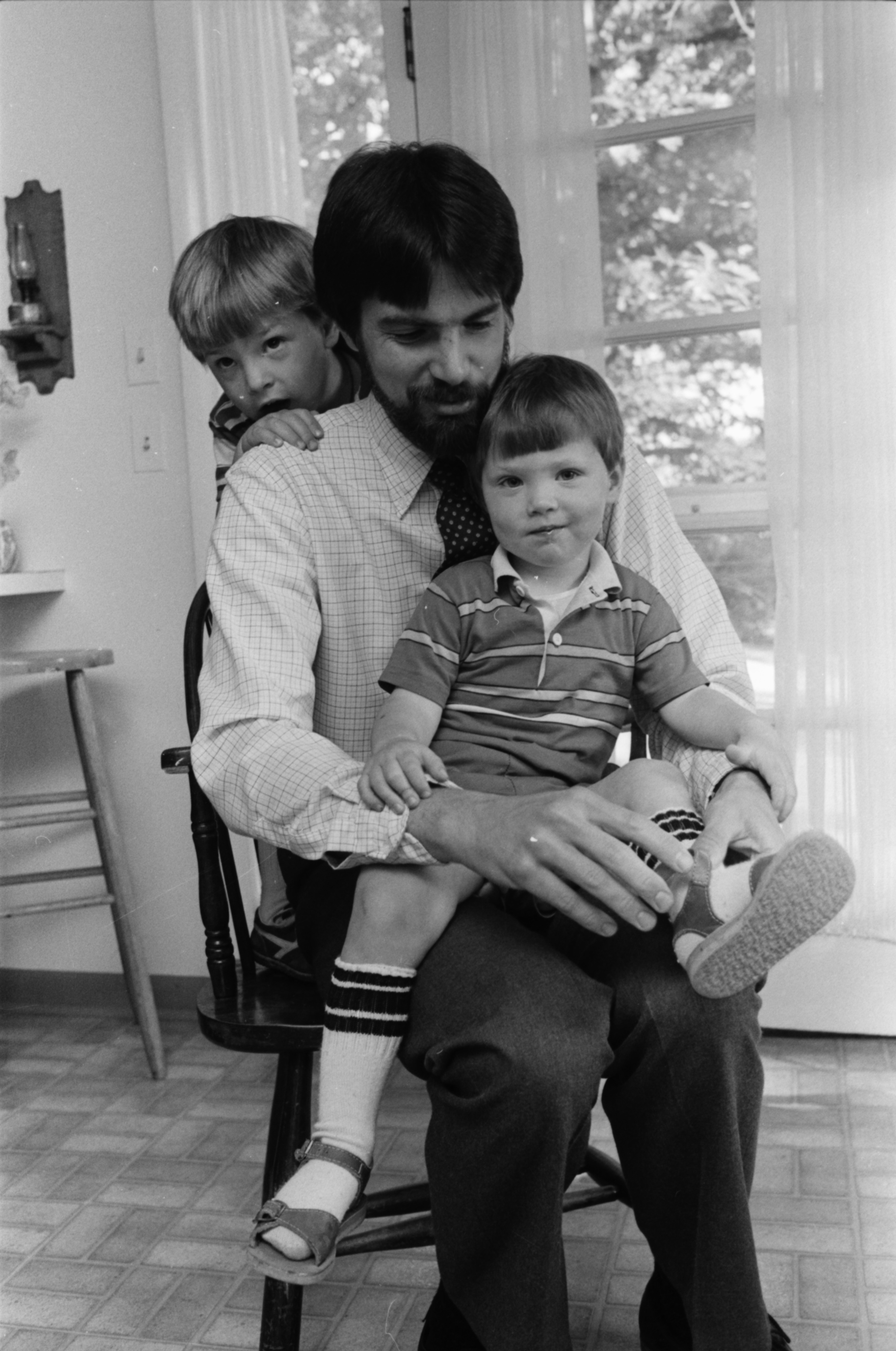 Doug Zimmer, with sons Jeff (in his lap) and David, June 1984 image
