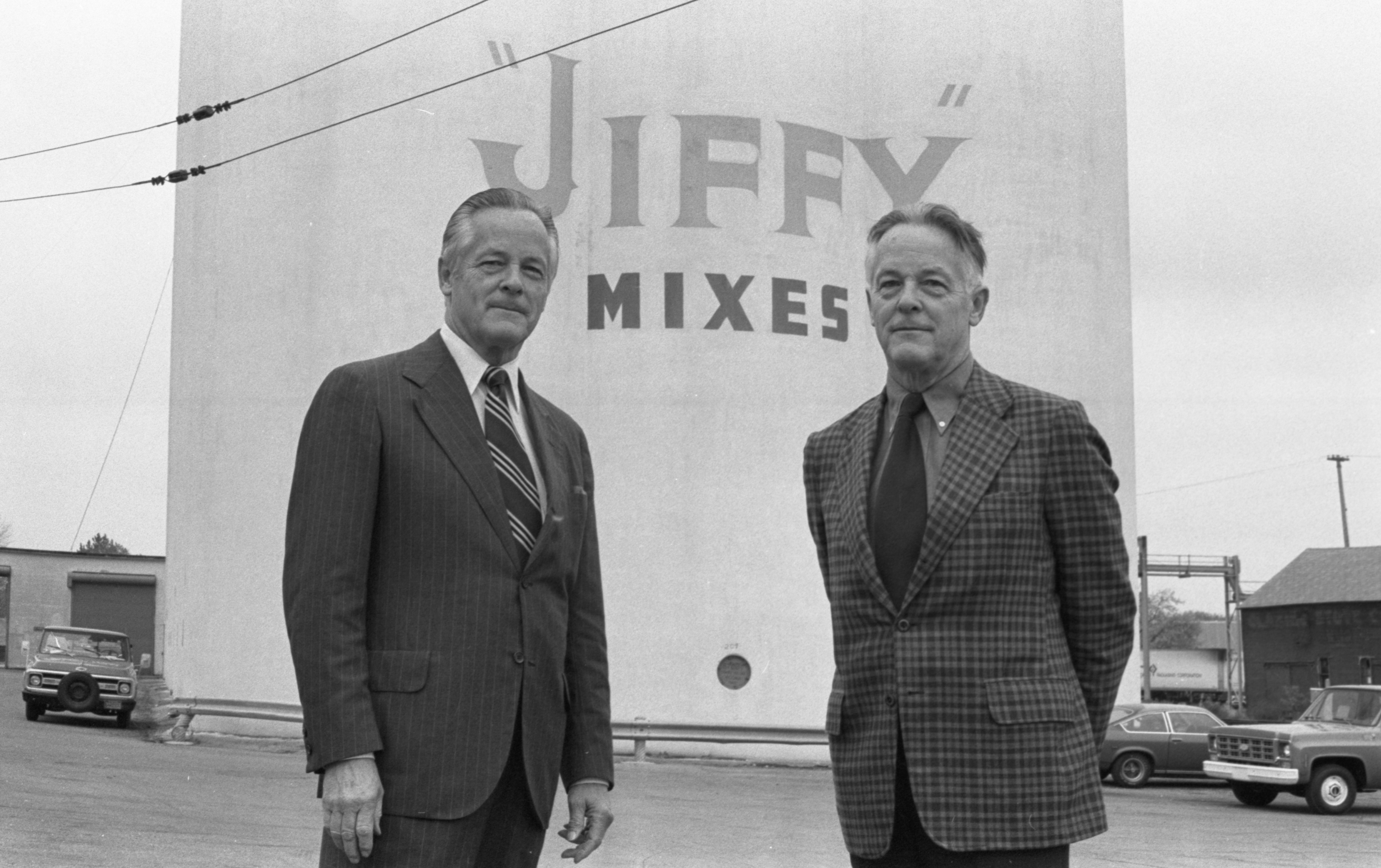 Howard Holmes, Chelsea Milling Co. President, & Twin Brother Dudley Holmes, Vice President, In Front Of The Jiffy Silos, October 1976 image