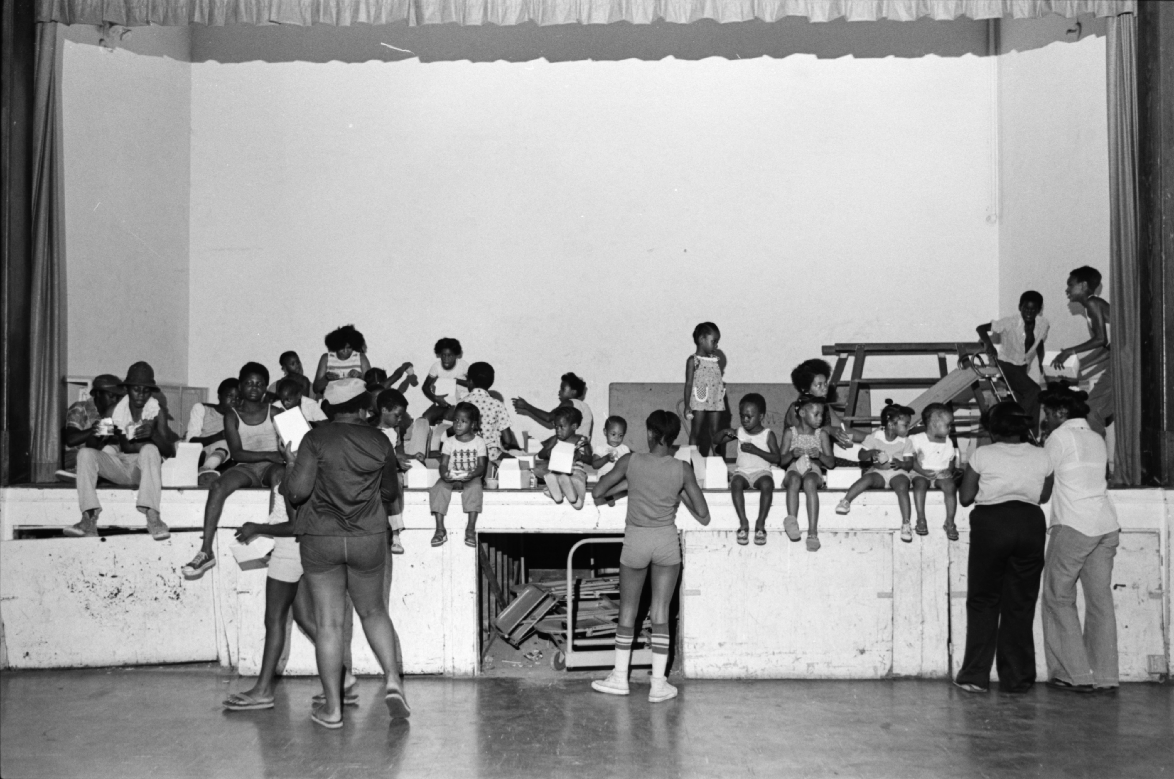 Ypsilanti Youths Eat Lunch on Stage at Parkridge Community Center, July 1978 image