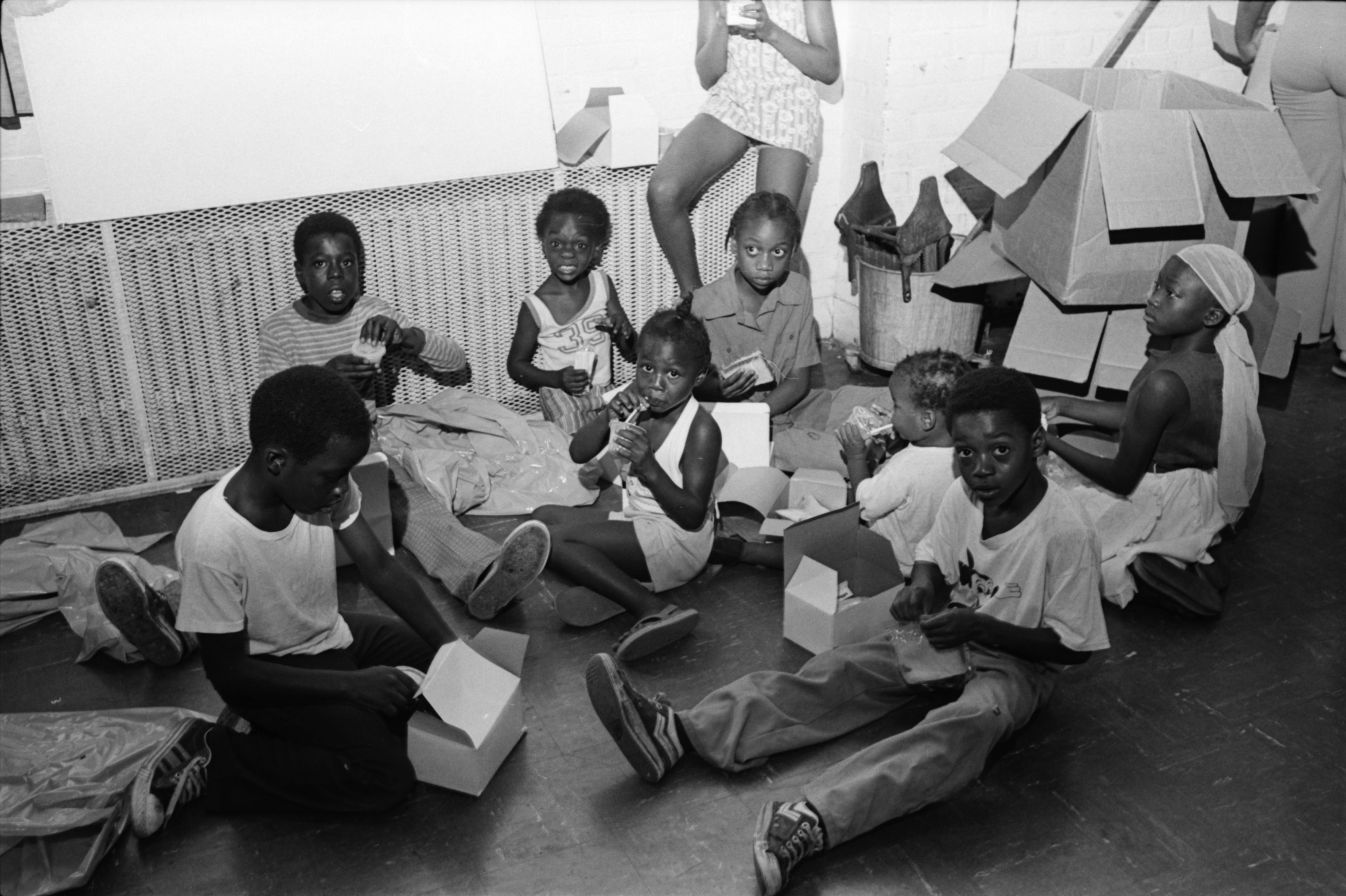 Ypsilanti Youths Eat Lunch on Floor at Run-Down Parkridge Community Center, July 1978 image