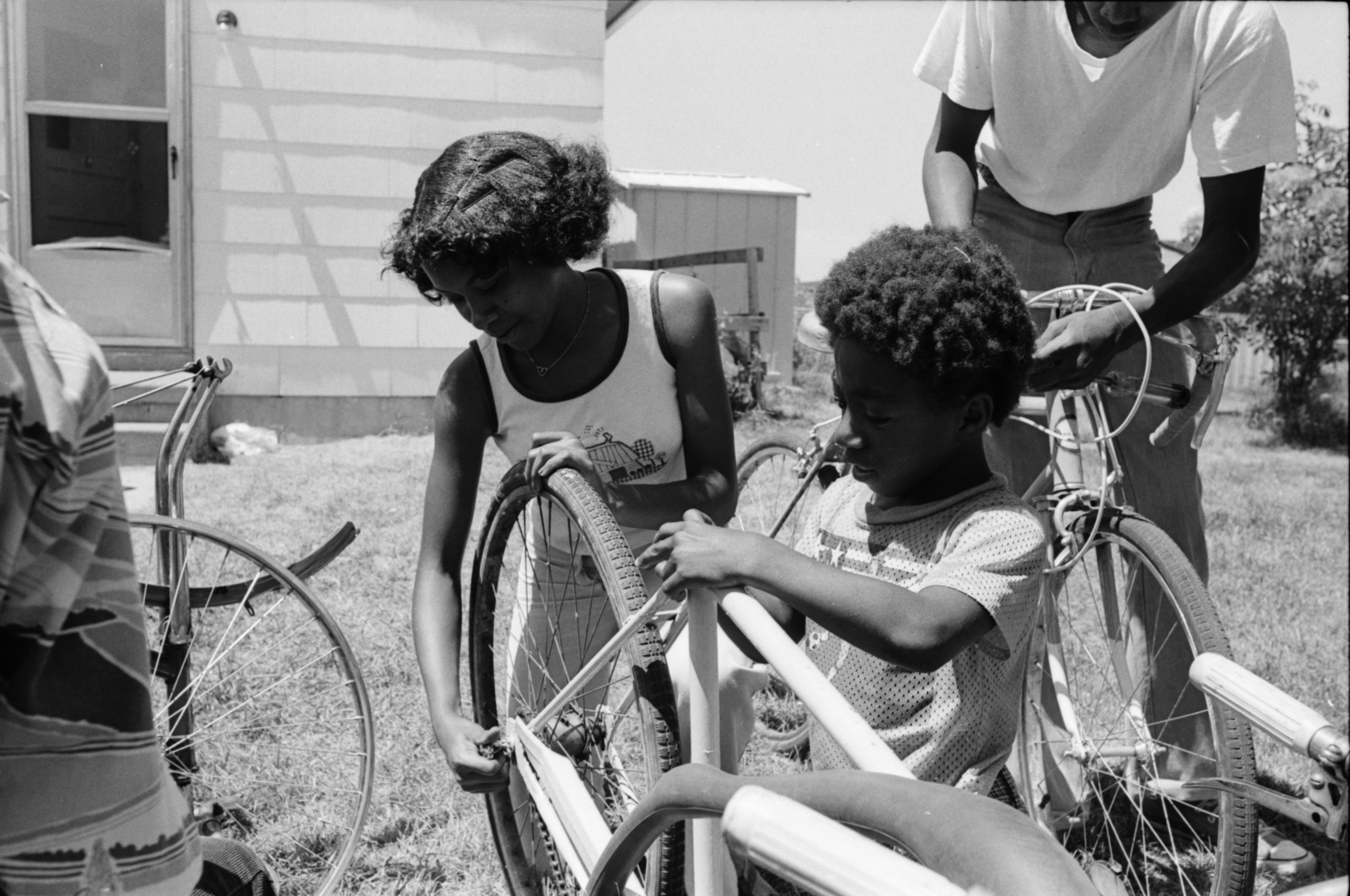 Monica Maddox And Kelvin Jones Fix Up A Bike, July 1978 image