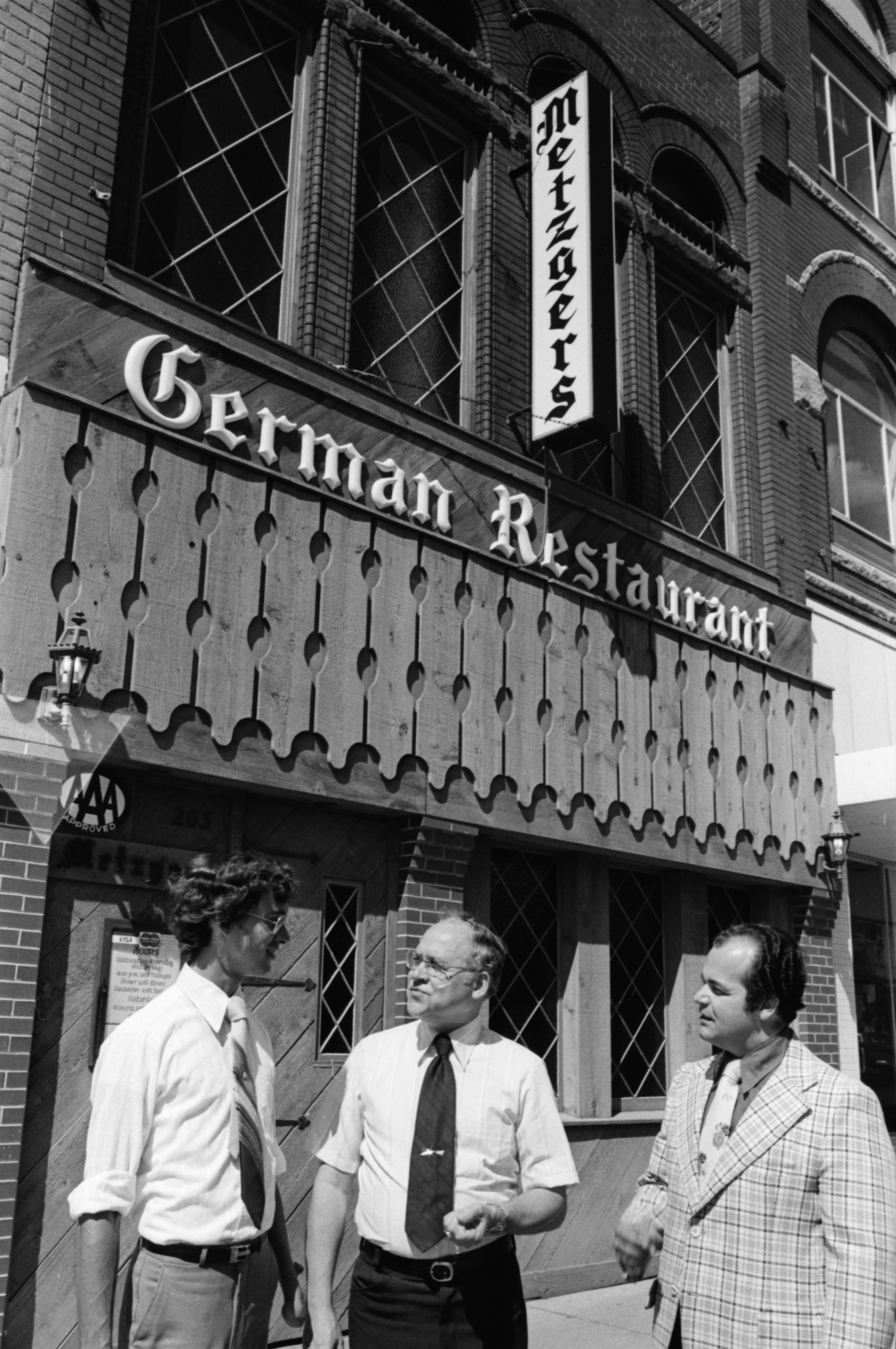 Walter Metzger, son John, and restaurant manager Douglas Kalis, July 1978 image