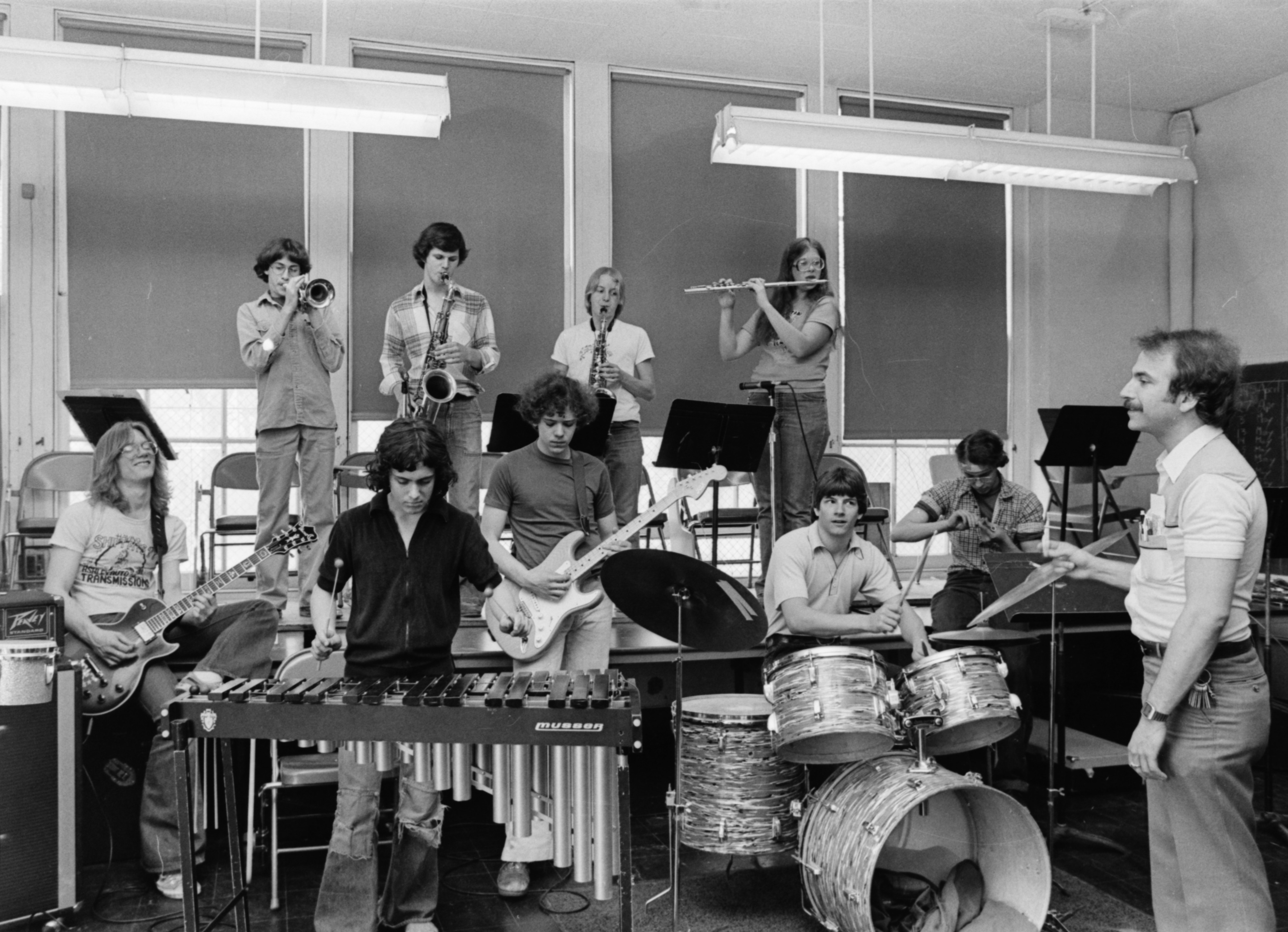 "Barton Polot conducts Community High School's ""Three O'Clock Band,"" April 1979 image"