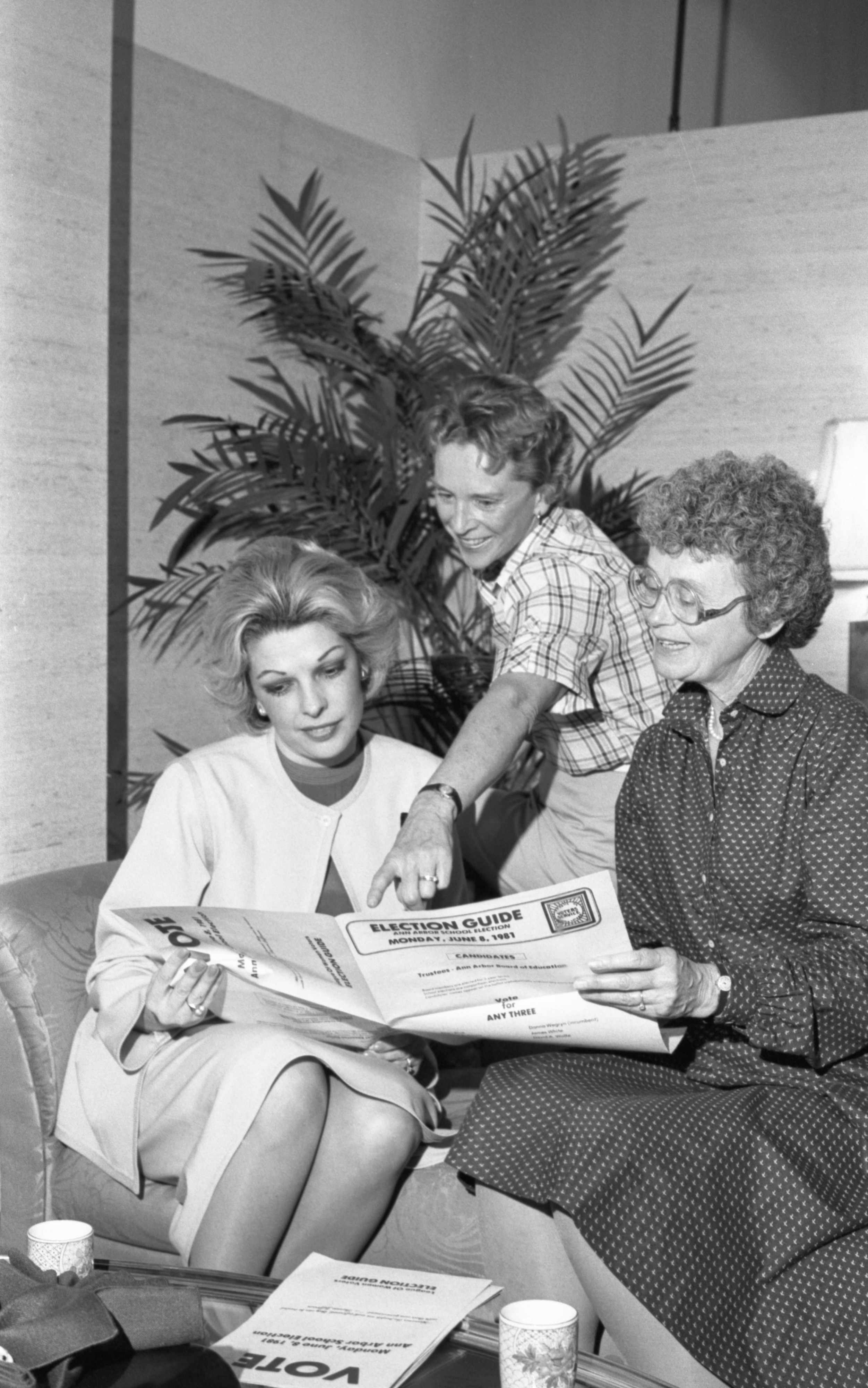 Carol Silvestro, Jo Howe, & Helen West With The League Of Women Voters Election Guide, June 1981 image