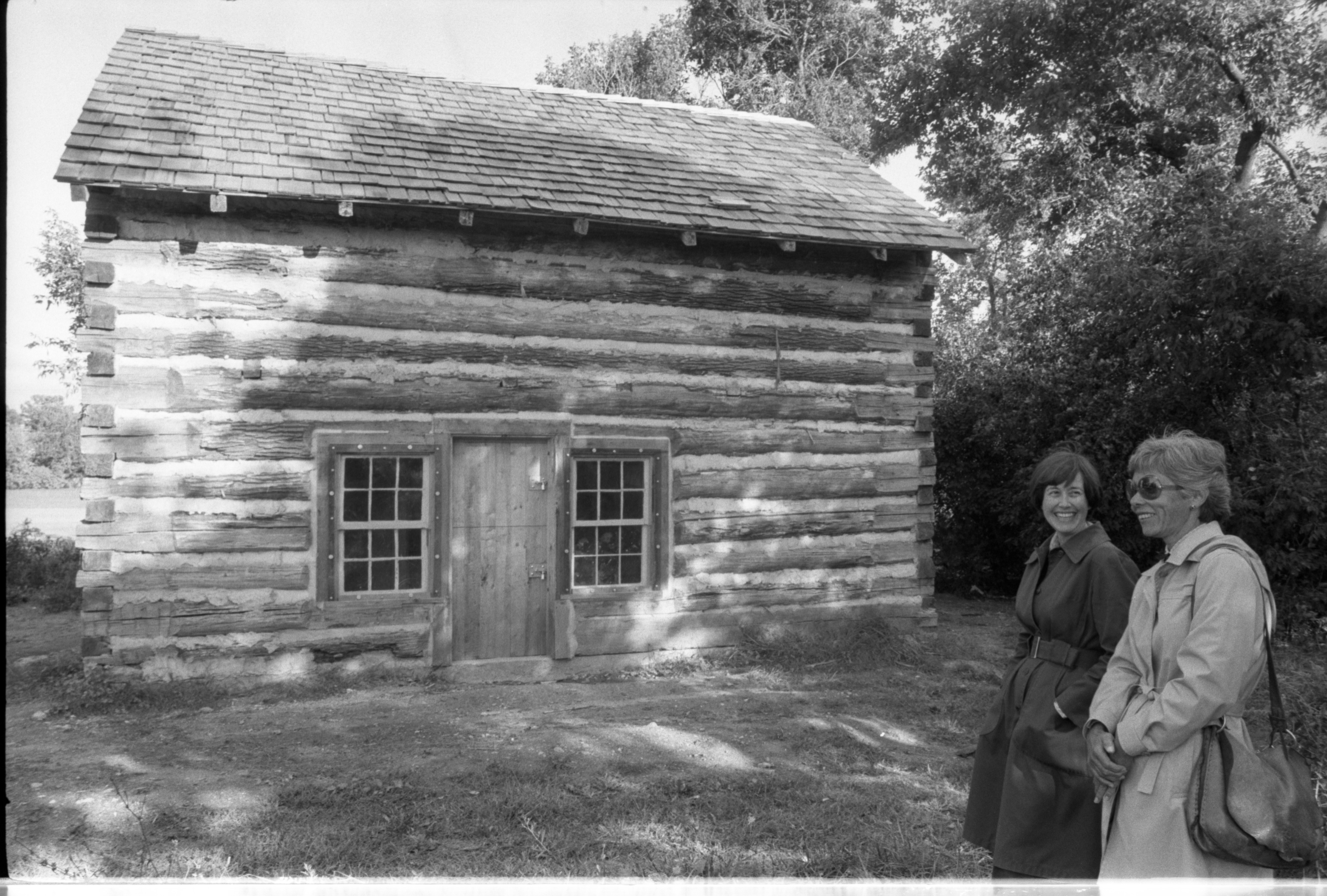 Frances Lyman, Left, & Elsie Dyke Walk By 141-Year-Old Log Cabin At Cobblestone Farm, September 27, 1981 image