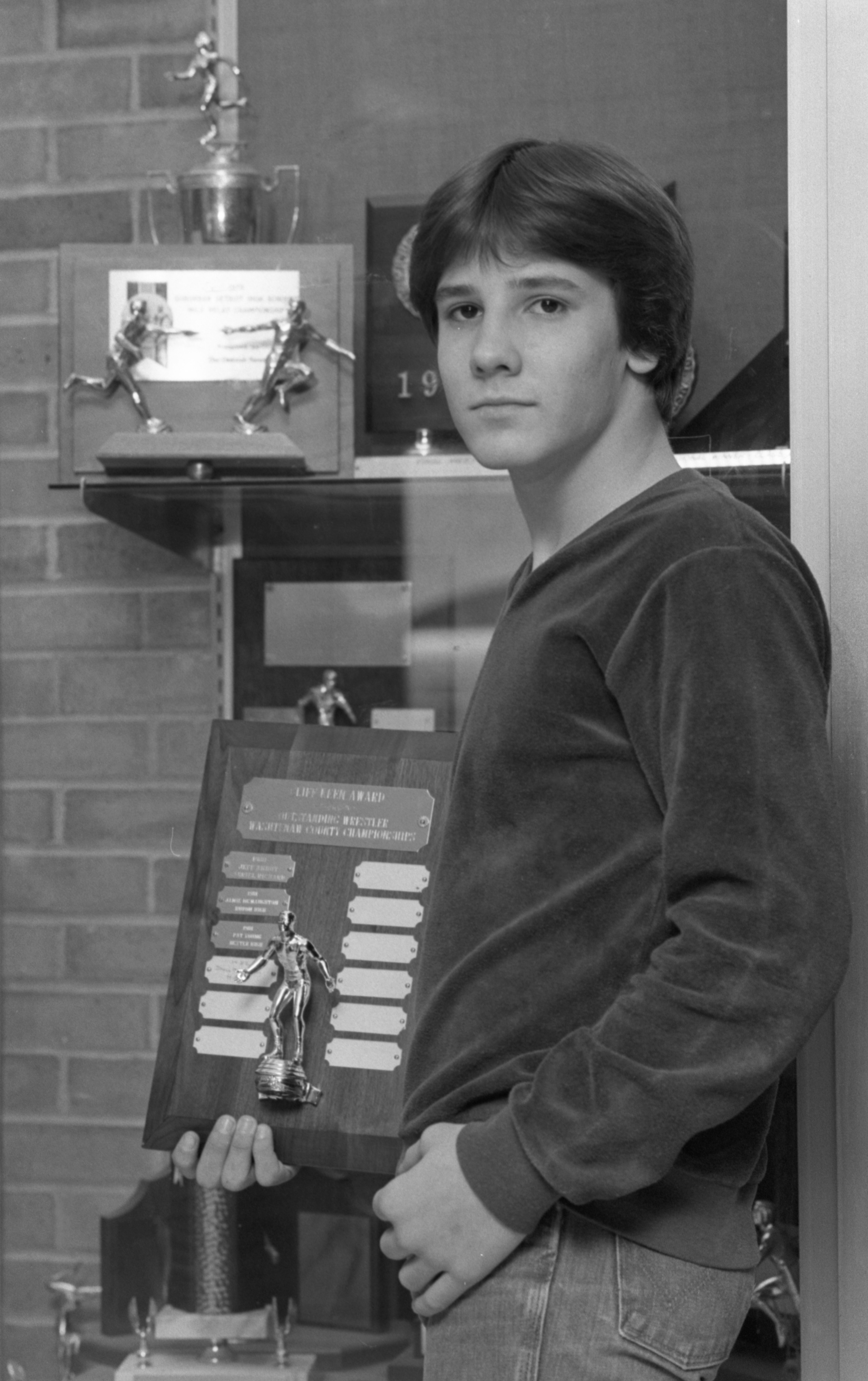 Jamie McNaughton, Champion Wrestler, Displays One Of His Awards, March 1982 image