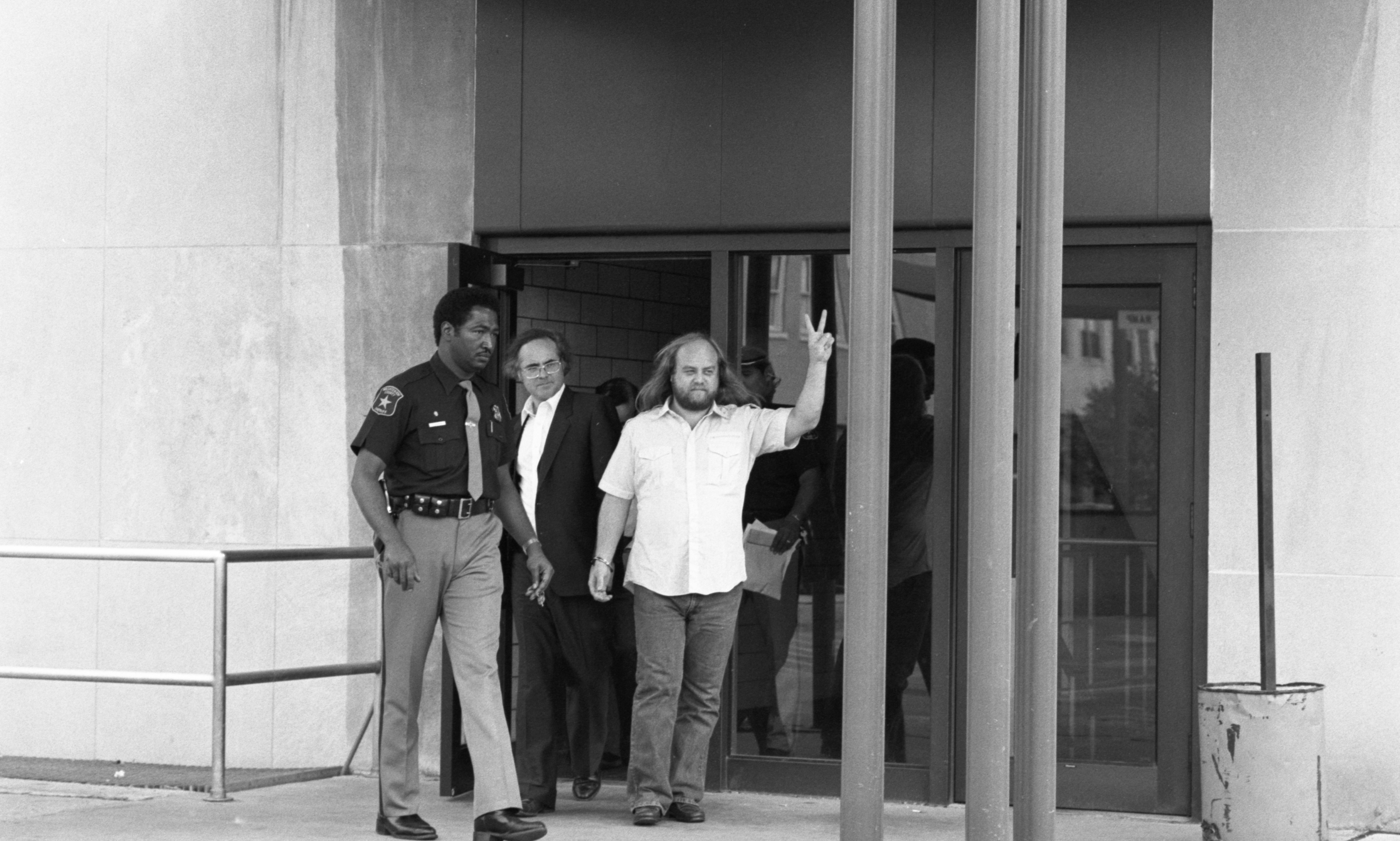 Deputy Larry Clemons Escorts Noel Lippman & Terry Shoultes To Jail - September 10, 1982 image