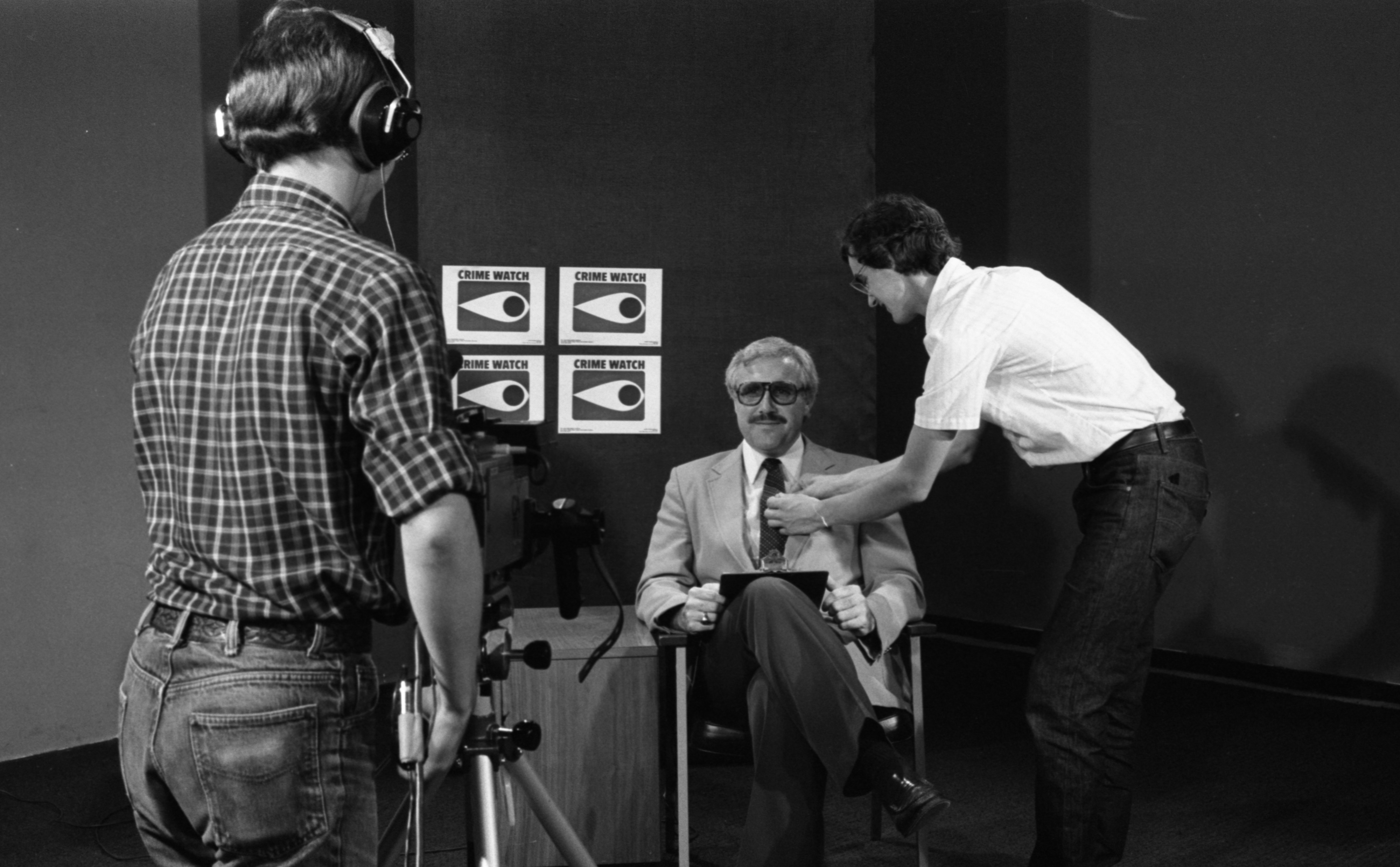 Ann Arbor Police Det. Jerry Wright Readies For Neighborhood Watch Report Cable Show, August 1984 image