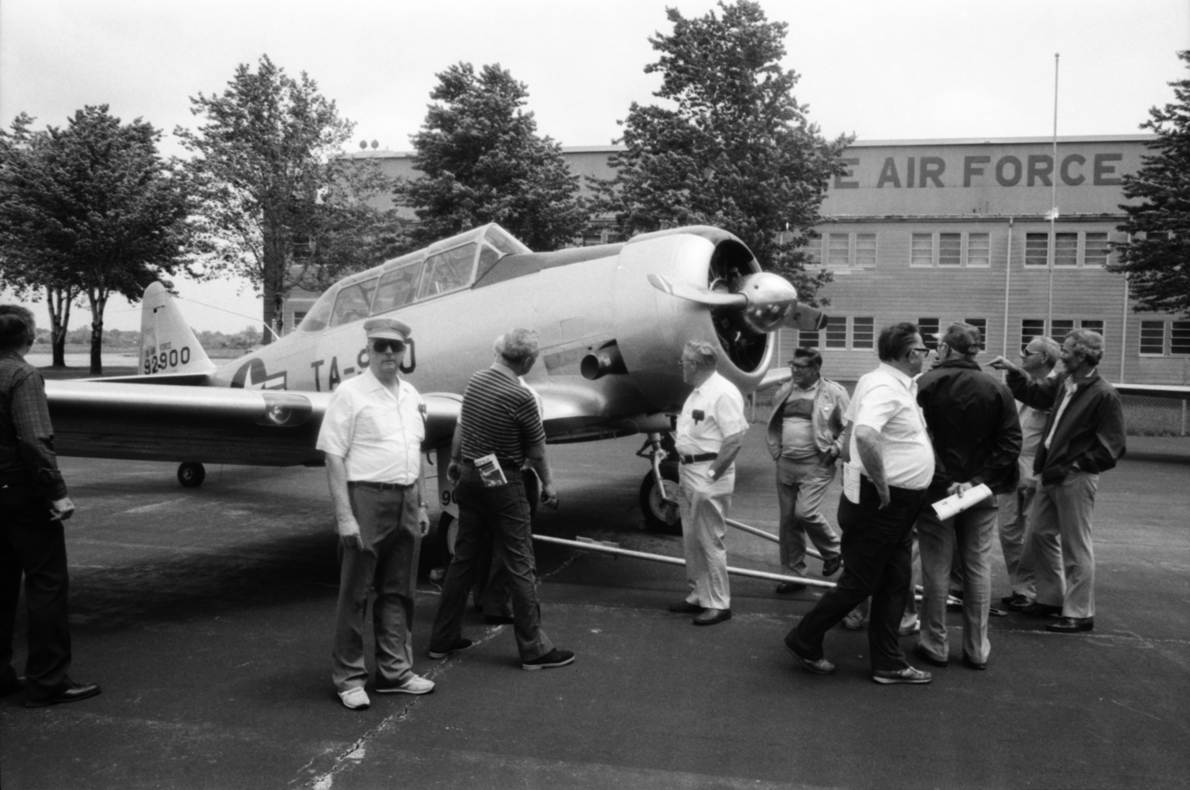 Former WWII POWs inspect a WWII-era plane, September 1986 image