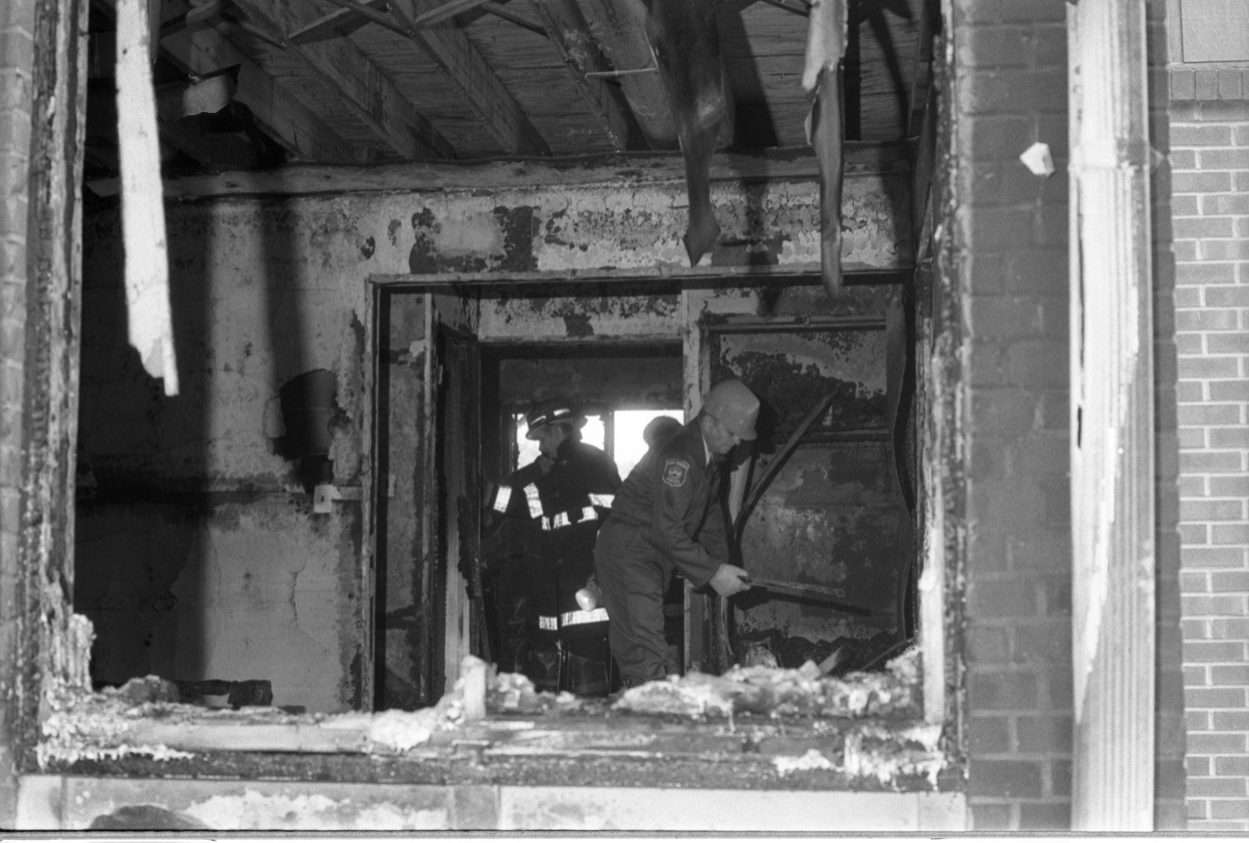 Firefighters Go Through Remains After Fire At The Hikone Court Townhomes, September 24, 1986 image