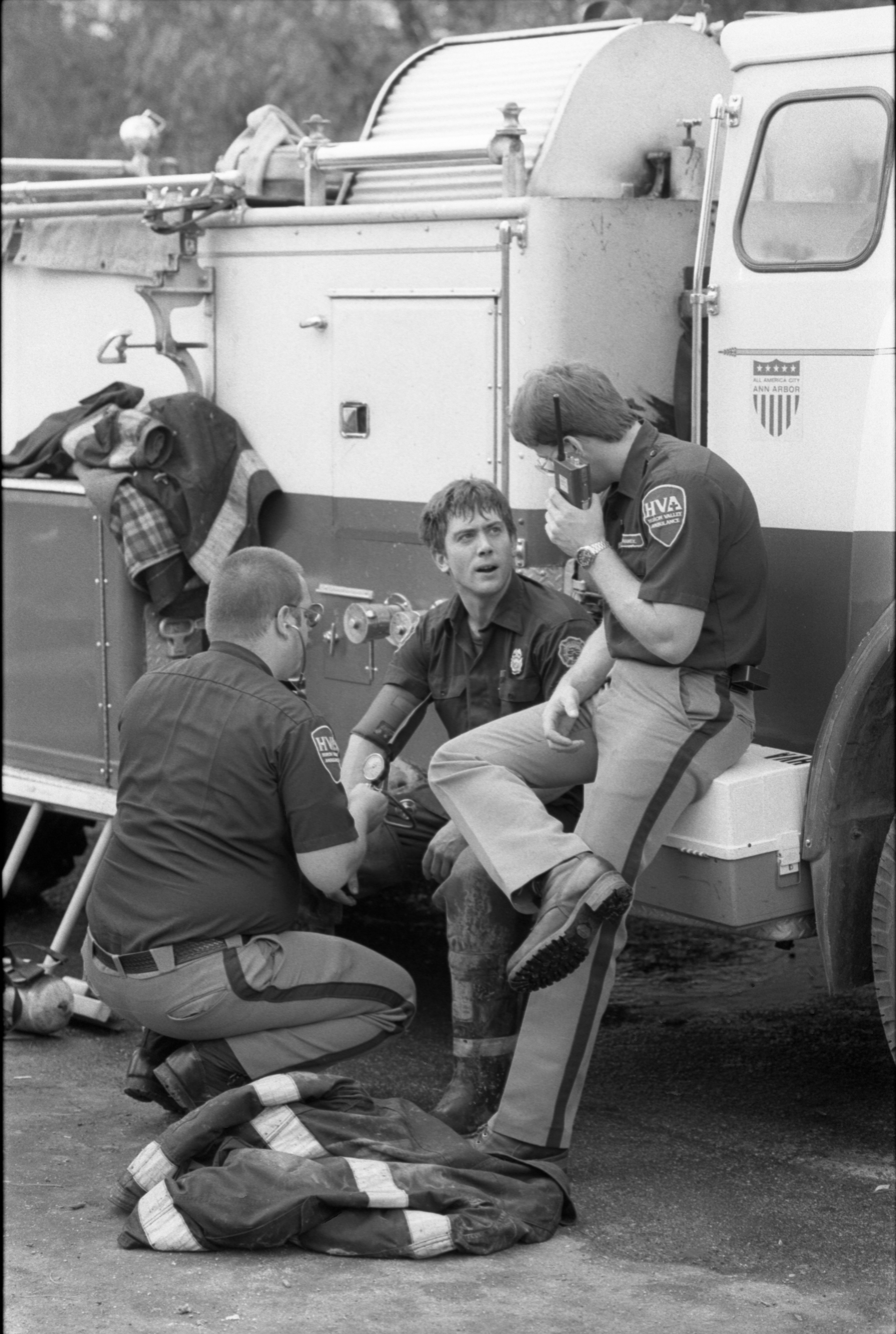Firefighter, Vince Lynch, Gets Check-Up By Paramedics After Fire At The Hikone Court Townhomes, September 24, 1986 image