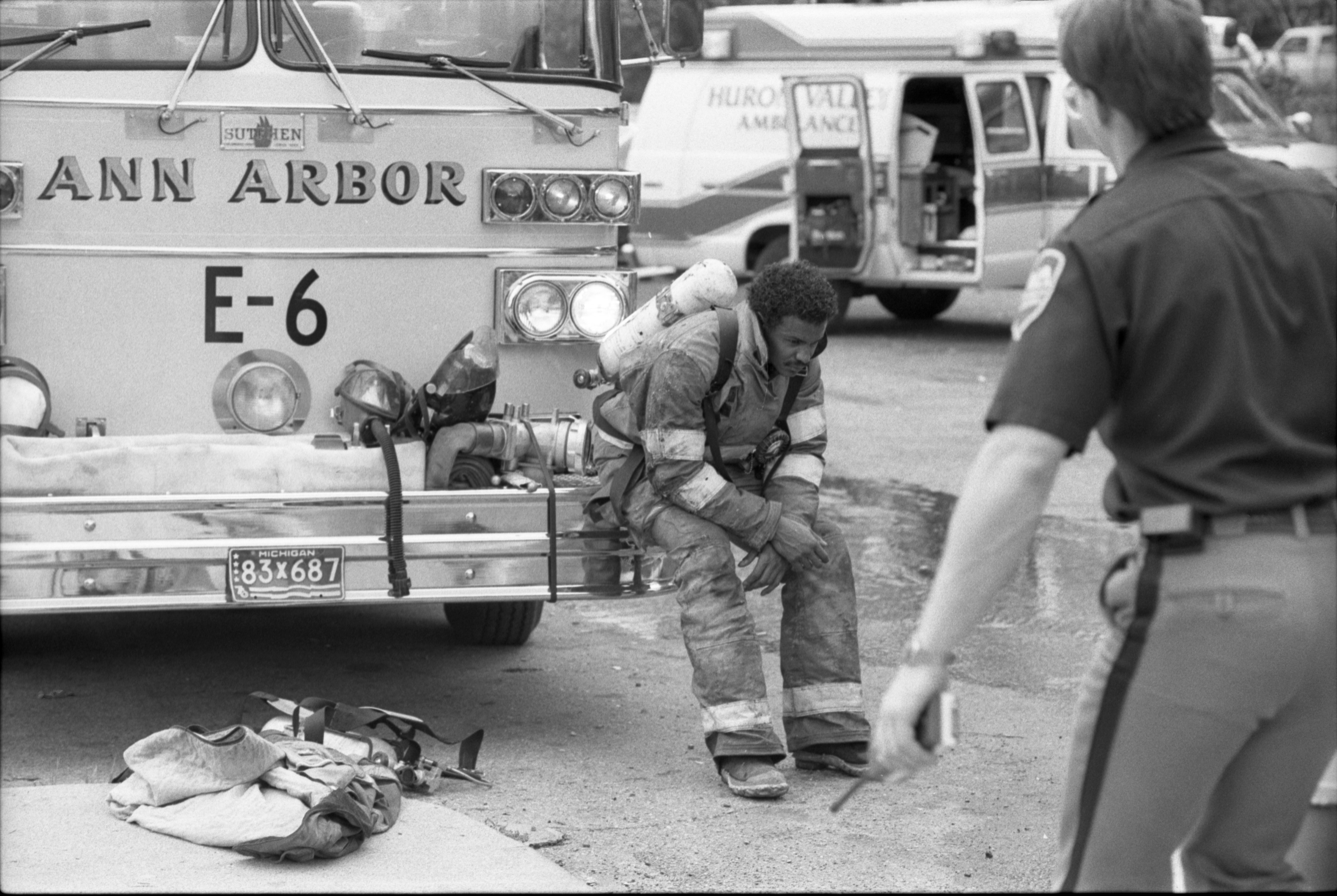 Firefighter, Chuck Hubbard After Fire Is Out At The Hikone Court Townhomes, September 24, 1986 image