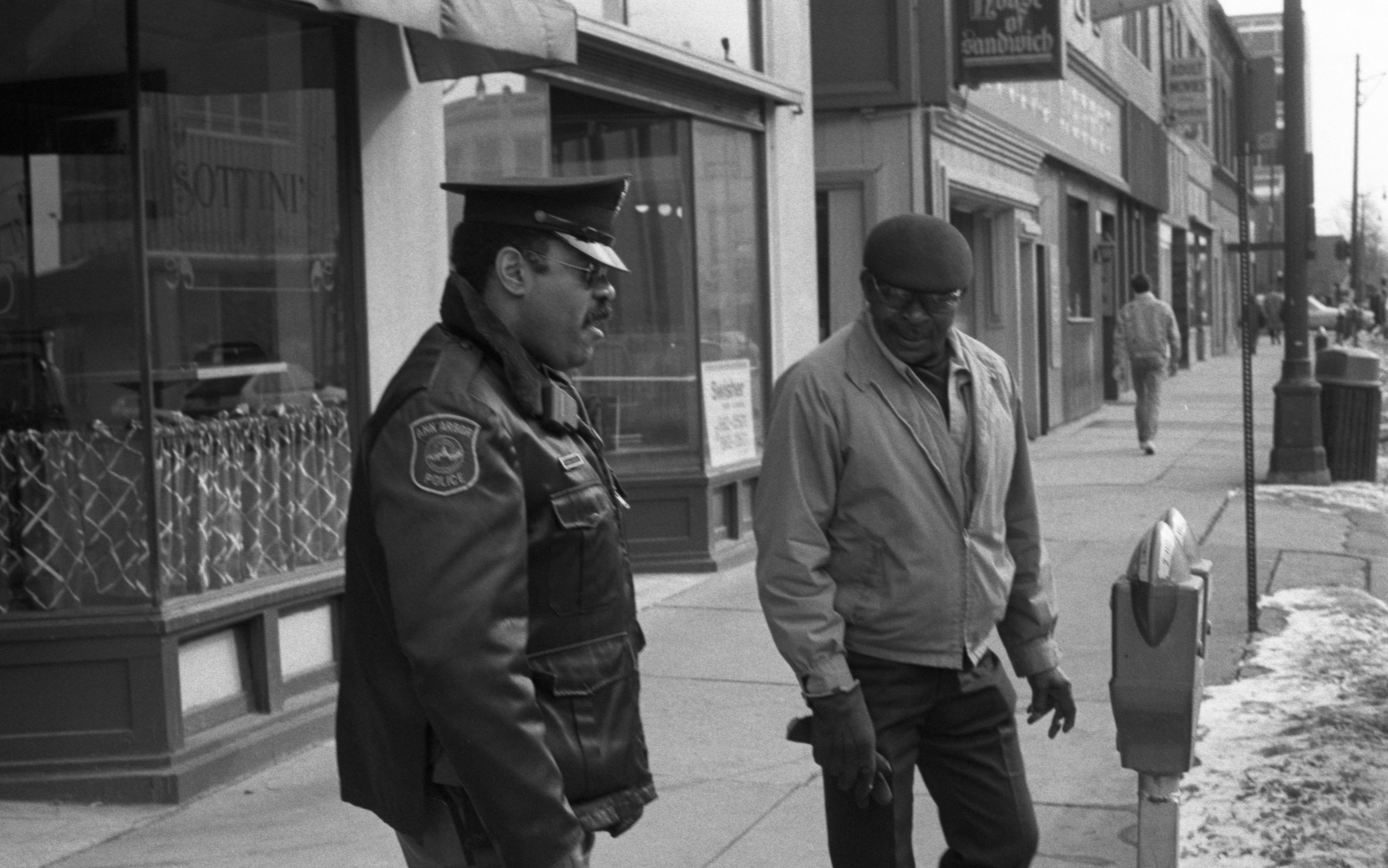 Ann Arbor Police Officer Richard A. Blake Walking Downtown Beat, February 1988 image