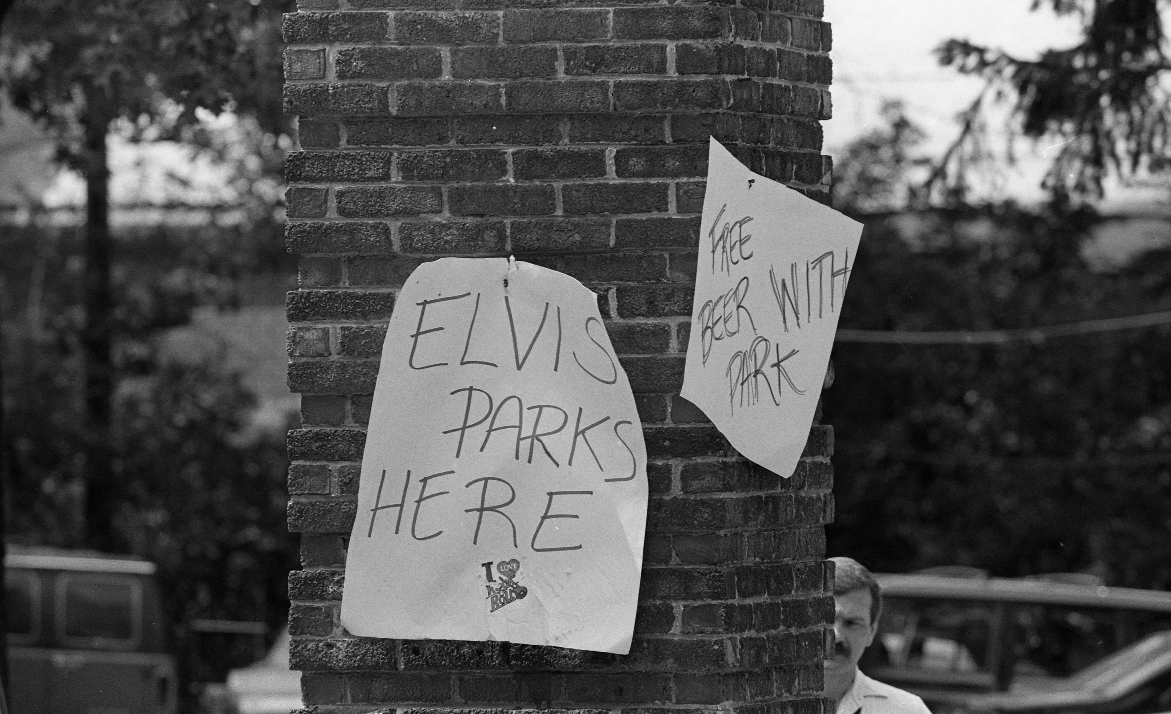 Chi Phi Fraternity Brothers With Sign To Lure Art Fair Parking Customers, July 1988 image