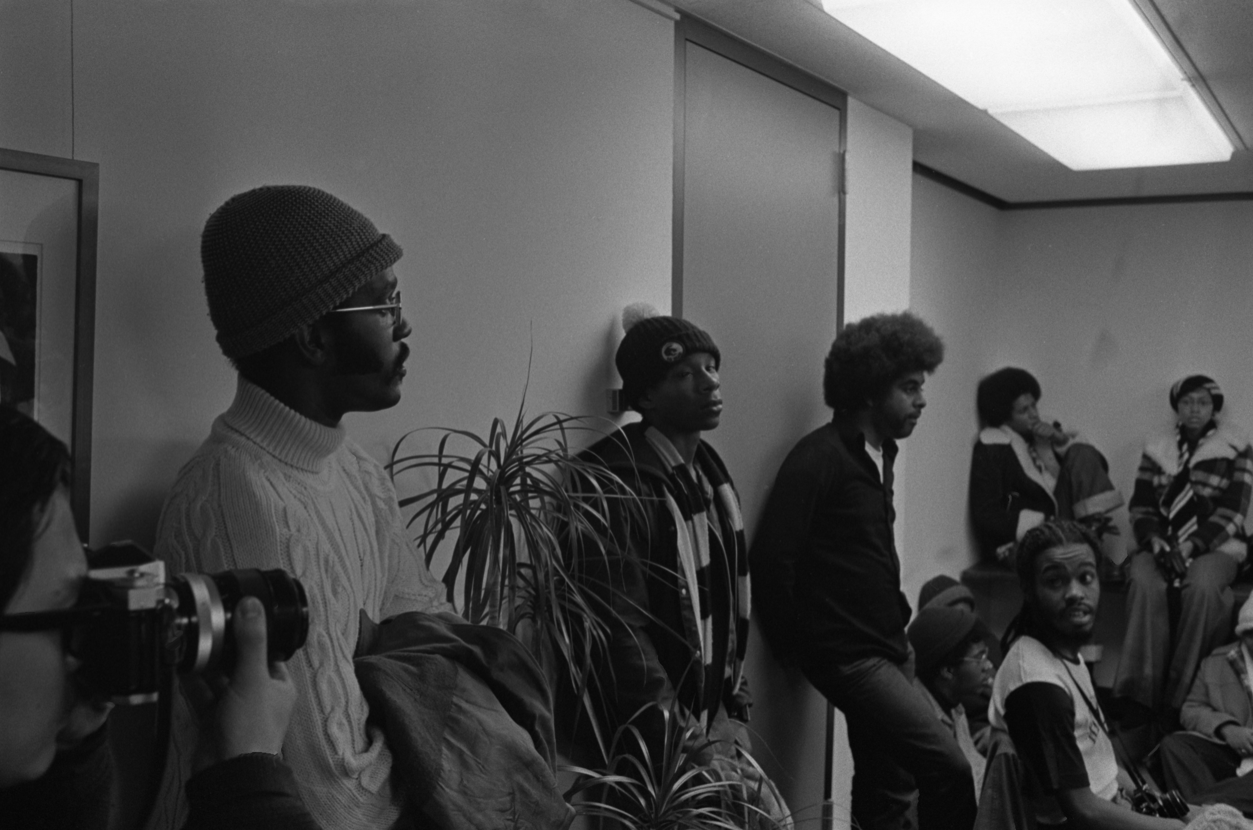 Black United Front Students Line Wall In Meeting With Robben Fleming, February 18, 1975 image