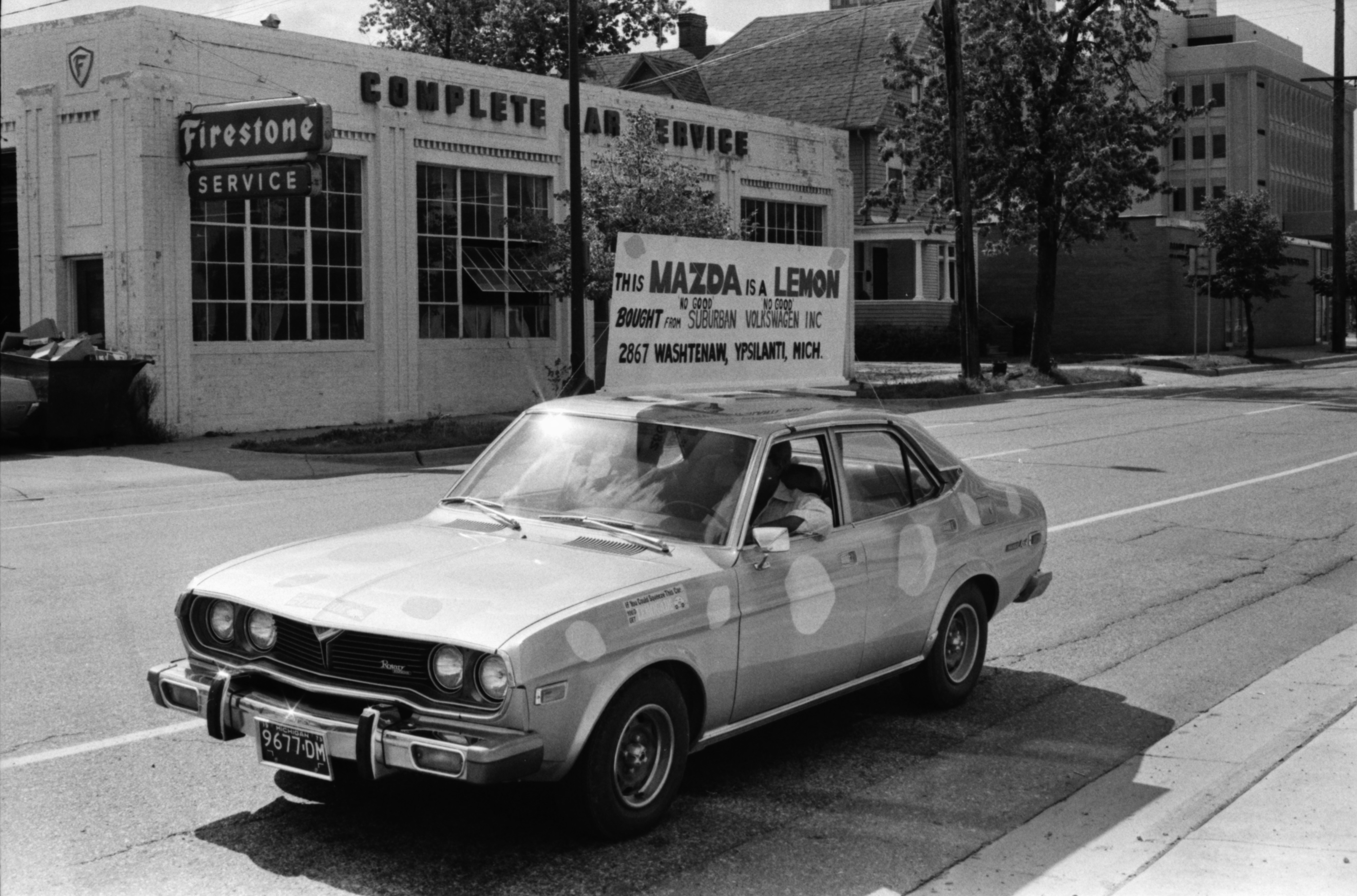 "Paul Wasson Drives a ""Lemon"" Mazda in Ypsilanti, August 1975 image"