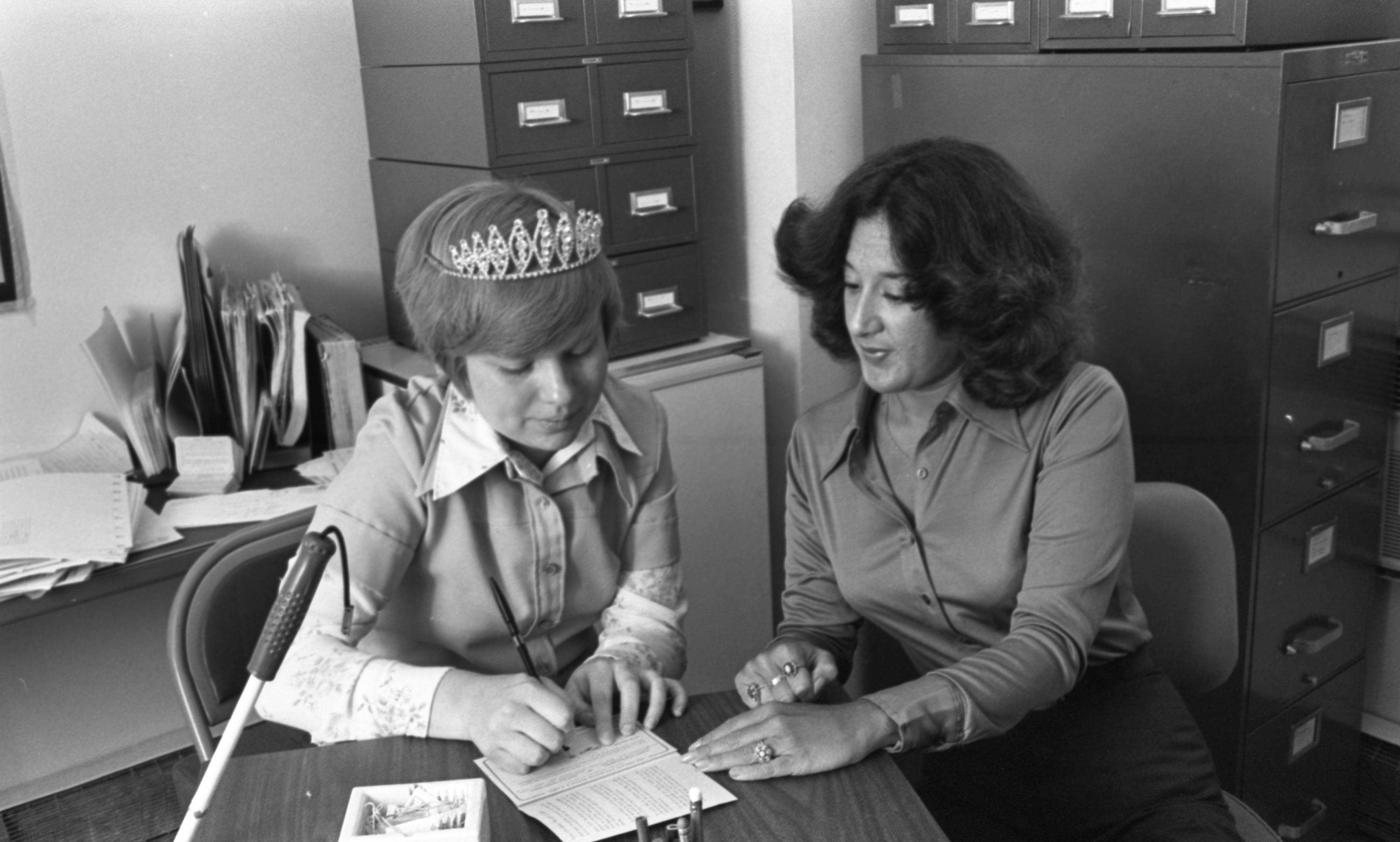Christine Smith, Michigan Lions' White Cane Queen, With Michigan Eye Bank Director, Patricia J. Krause, April 1977 image