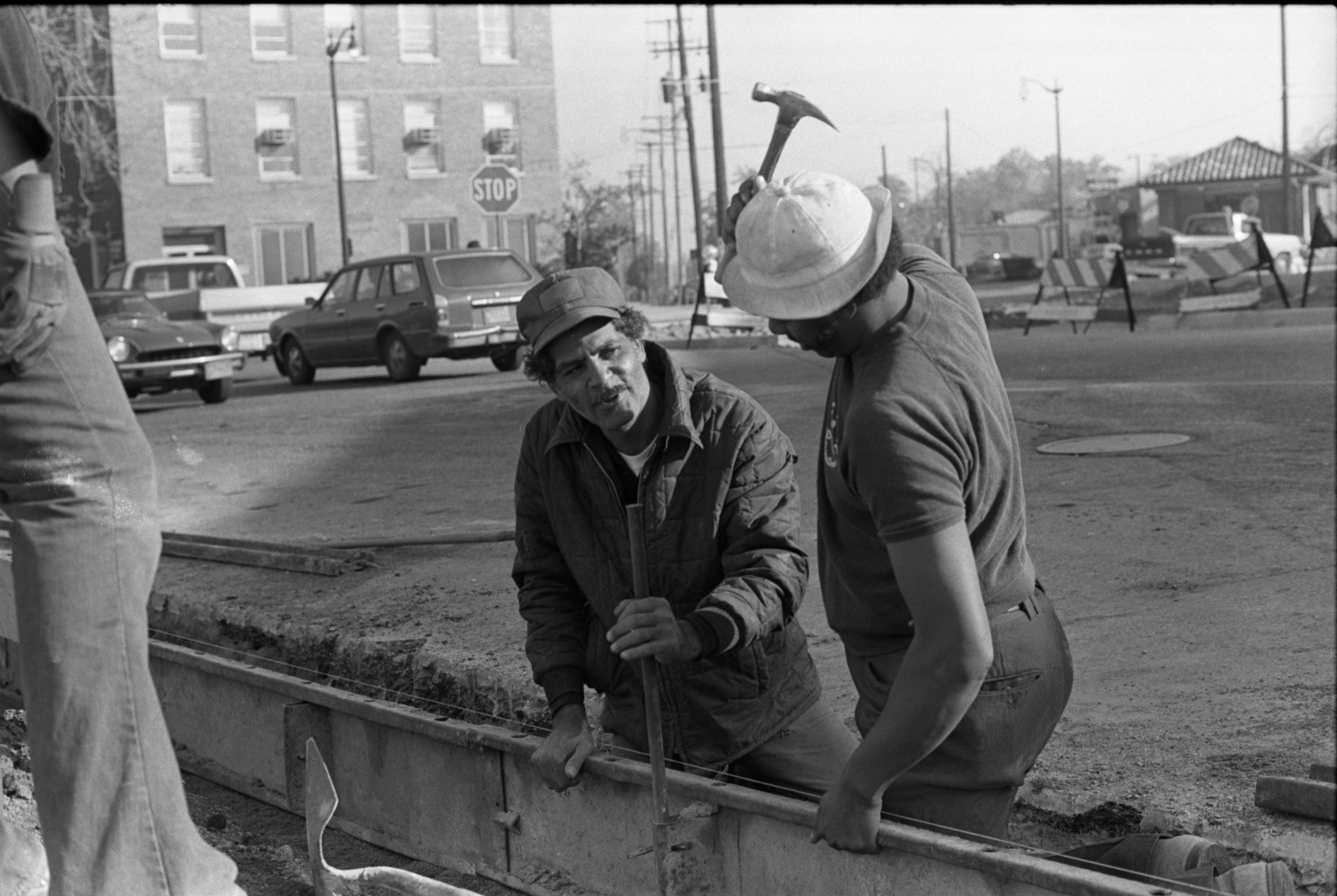 Calvert Brothers Employees Jesse Campbell, On Right, & Marvin Baker Work On N. Fourth Avenue, October 1977 image