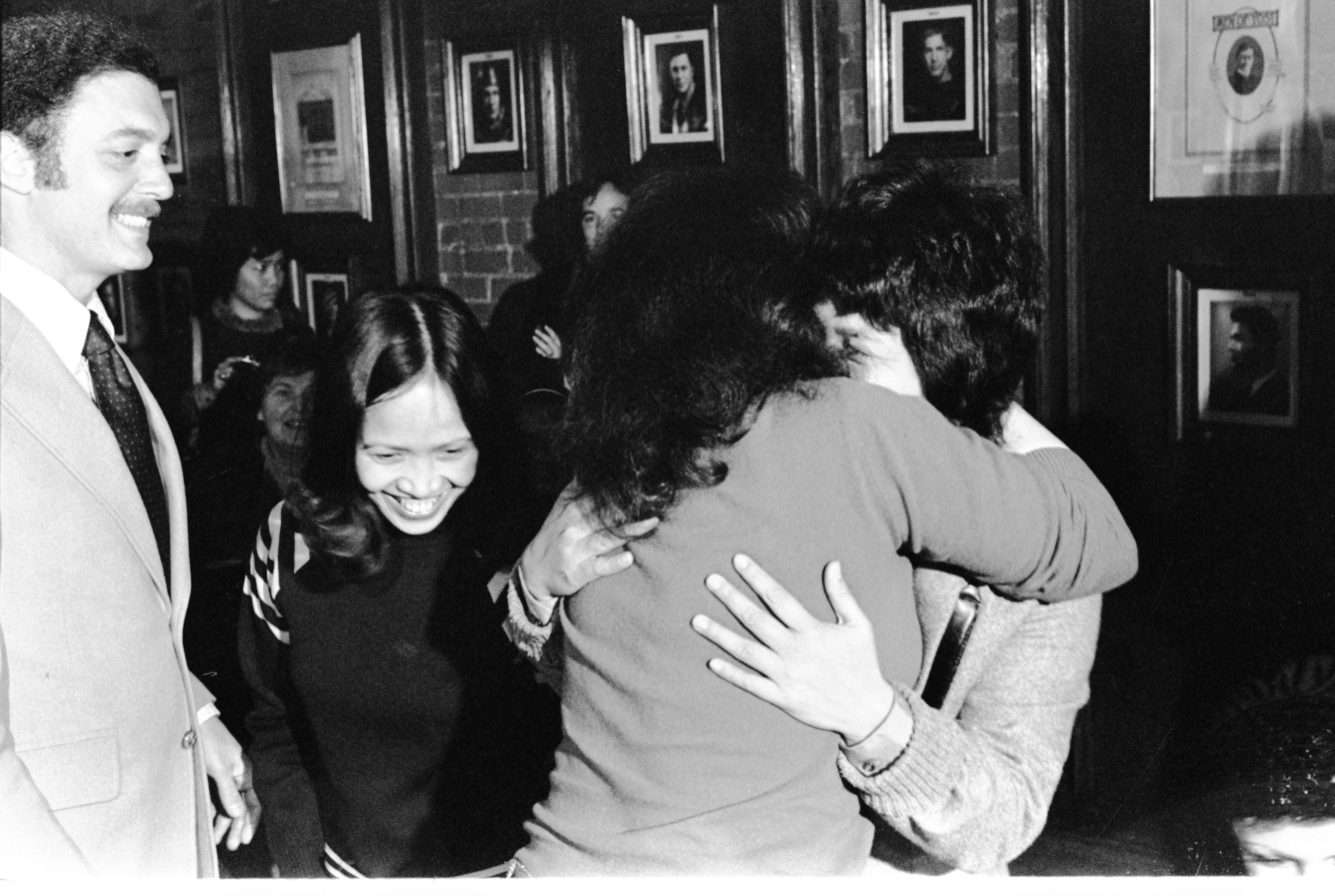 VA Nurses, Filipina Narciso Getting Hug From Friend, & Leonora Perez Leaving Press Conference After Hearing About Retrial, December 1977 image