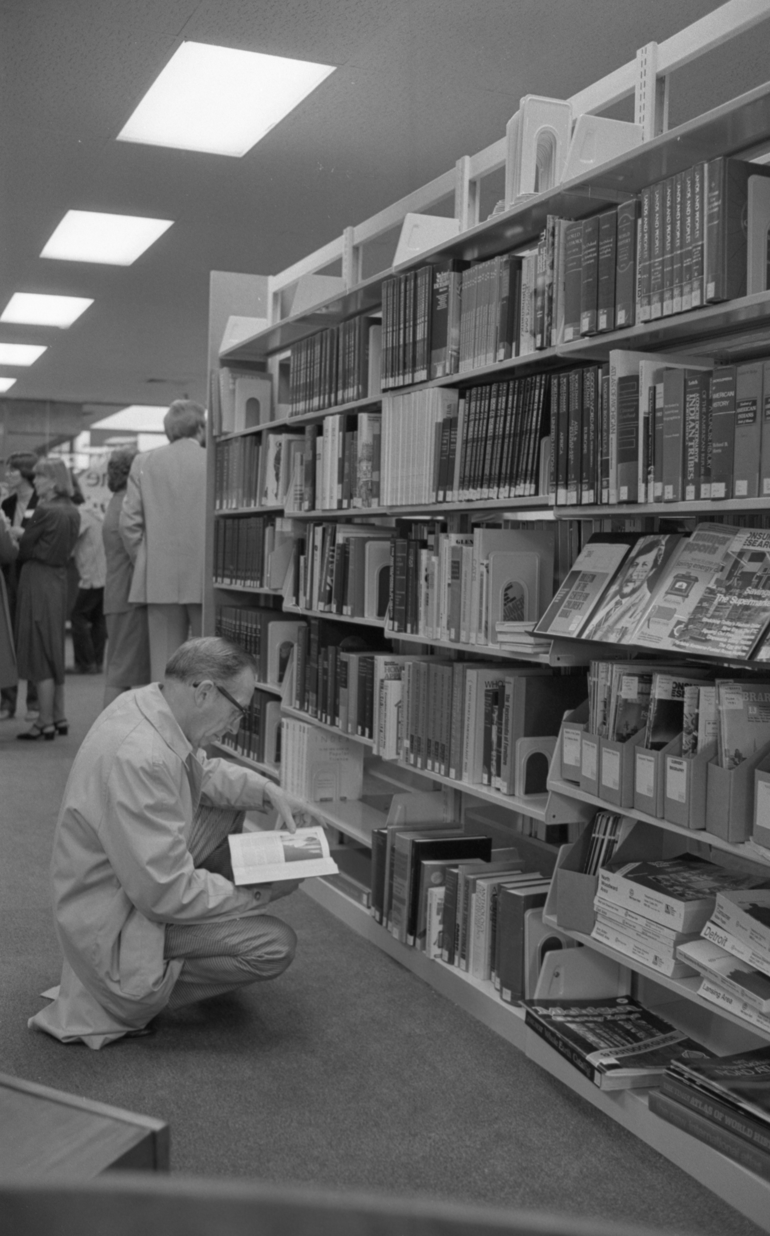 Forest Alter Browses Books At The Grand Opening Of The New Northeast Branch Of The Ann Arbor Public Library, October 1981 image