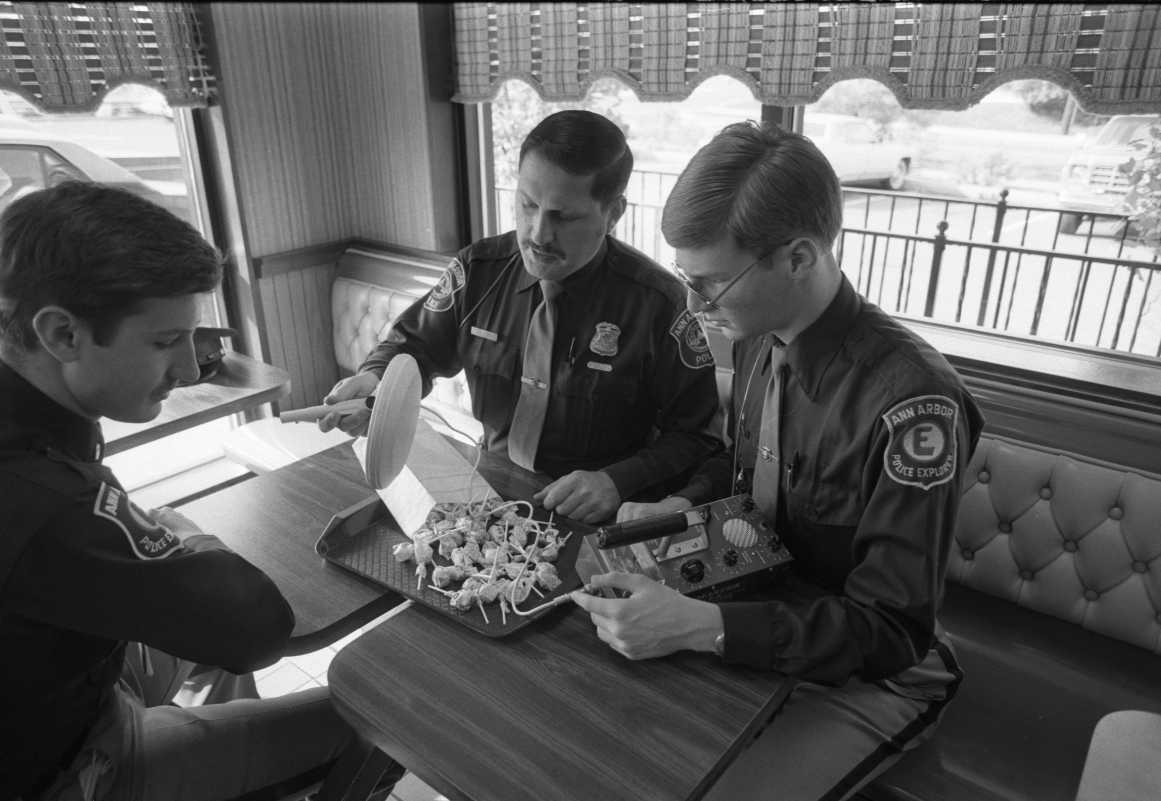 Ann Arbor Police Officer and Explorers Check Halloween Candy With Metal Detector, October 1982 image