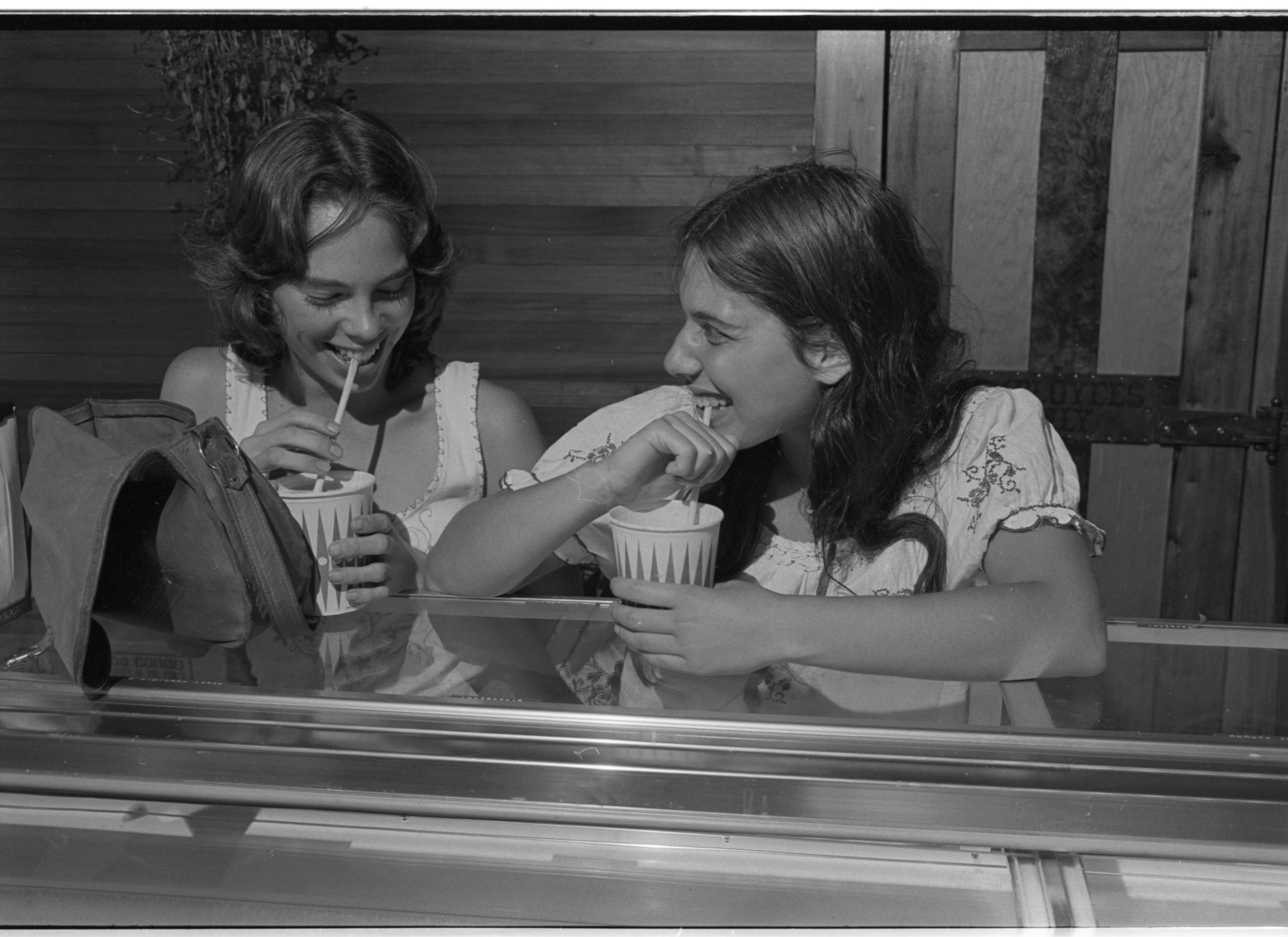 Sharing Milk Shakes At Mountain High Ice Cream Parlour, August 1974 image