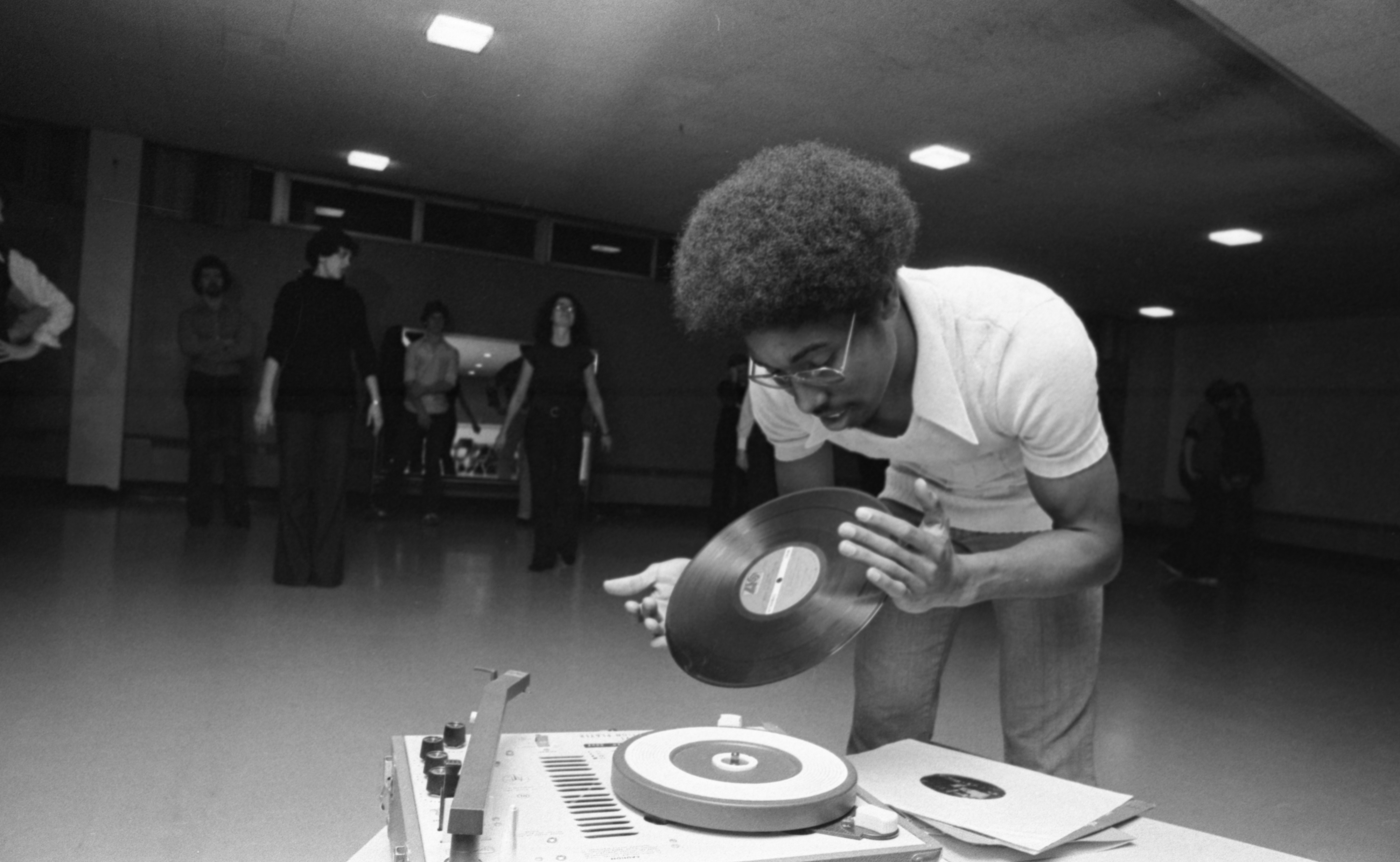 Dorian Deaver Flips A Record For His Disco Class At The Ann Arbor Y, November 1976 image