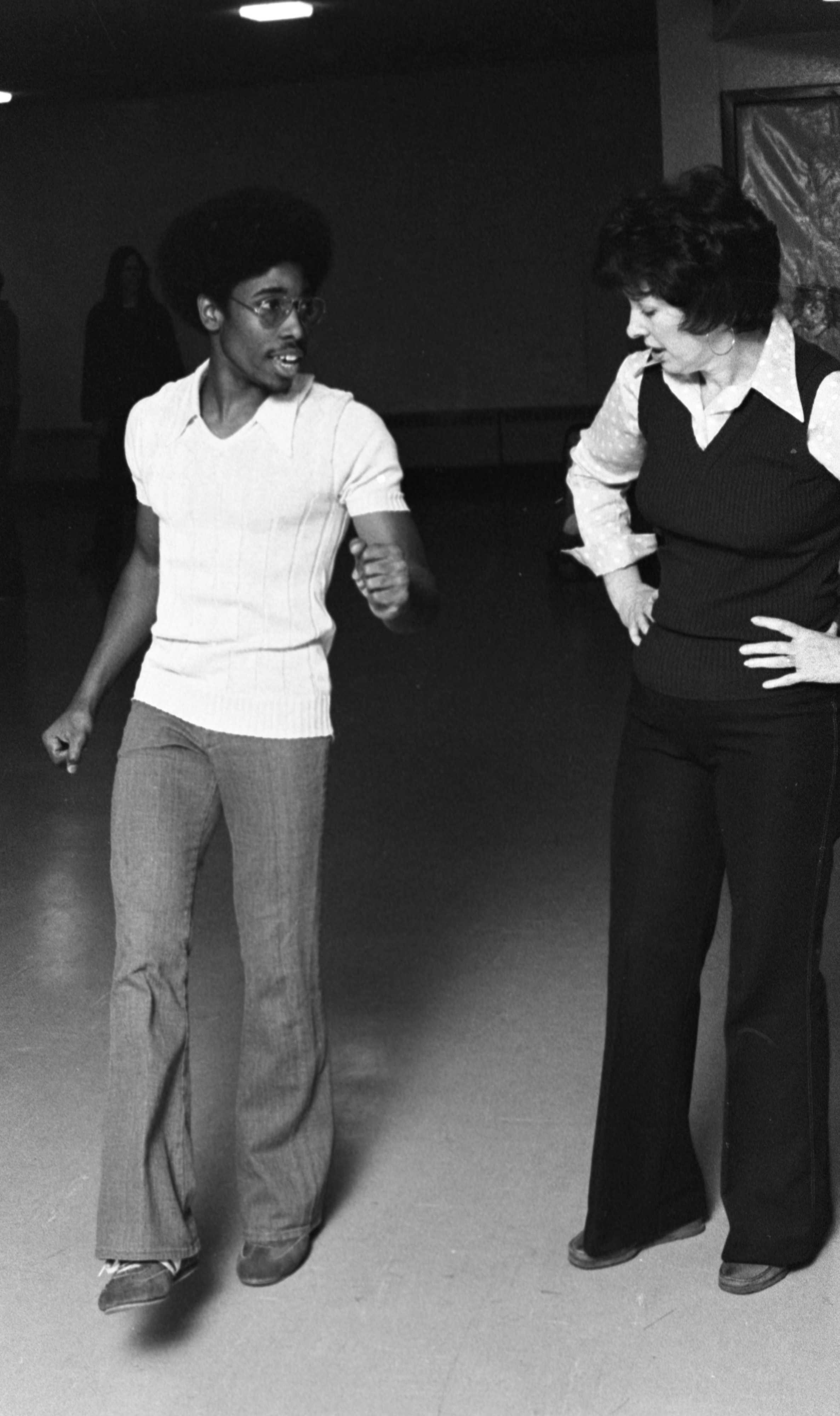 Dorian Deaver Demonstrates A Dance Move For A Student In His Disco Class At The Ann Arbor Y, November 1976 image