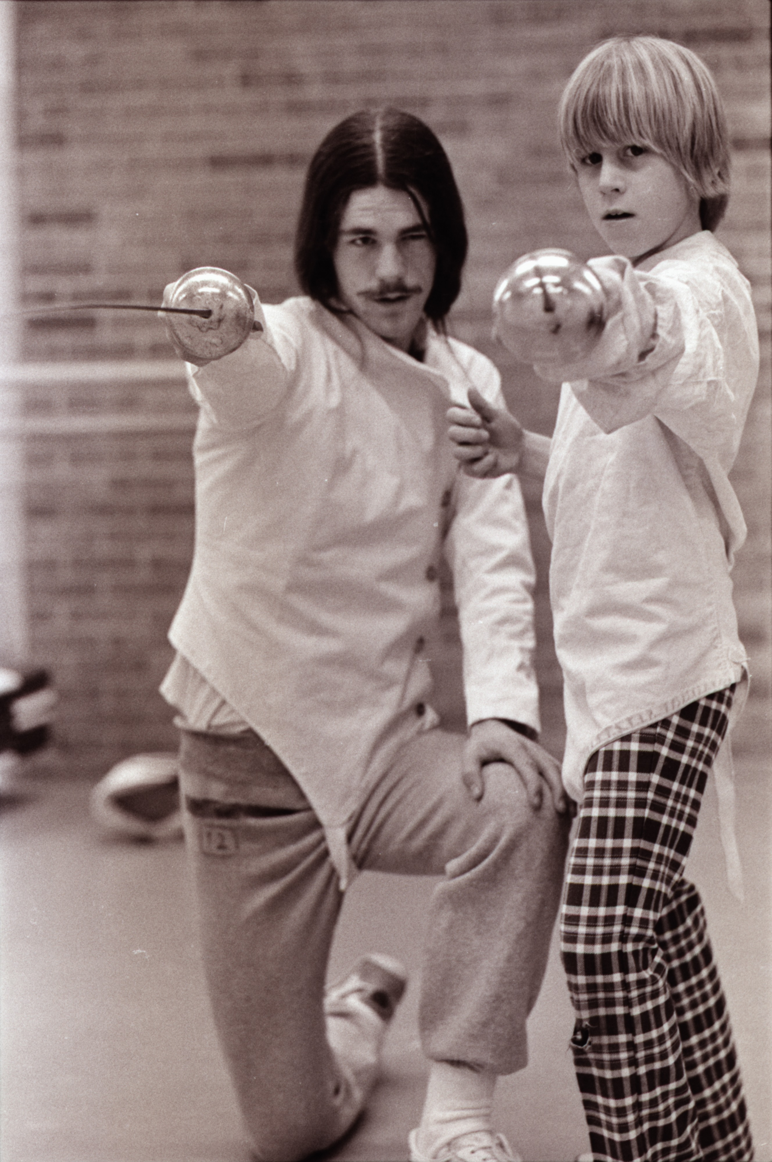 Student Practices Fencing at the Ann Arbor Y, December 1976 image