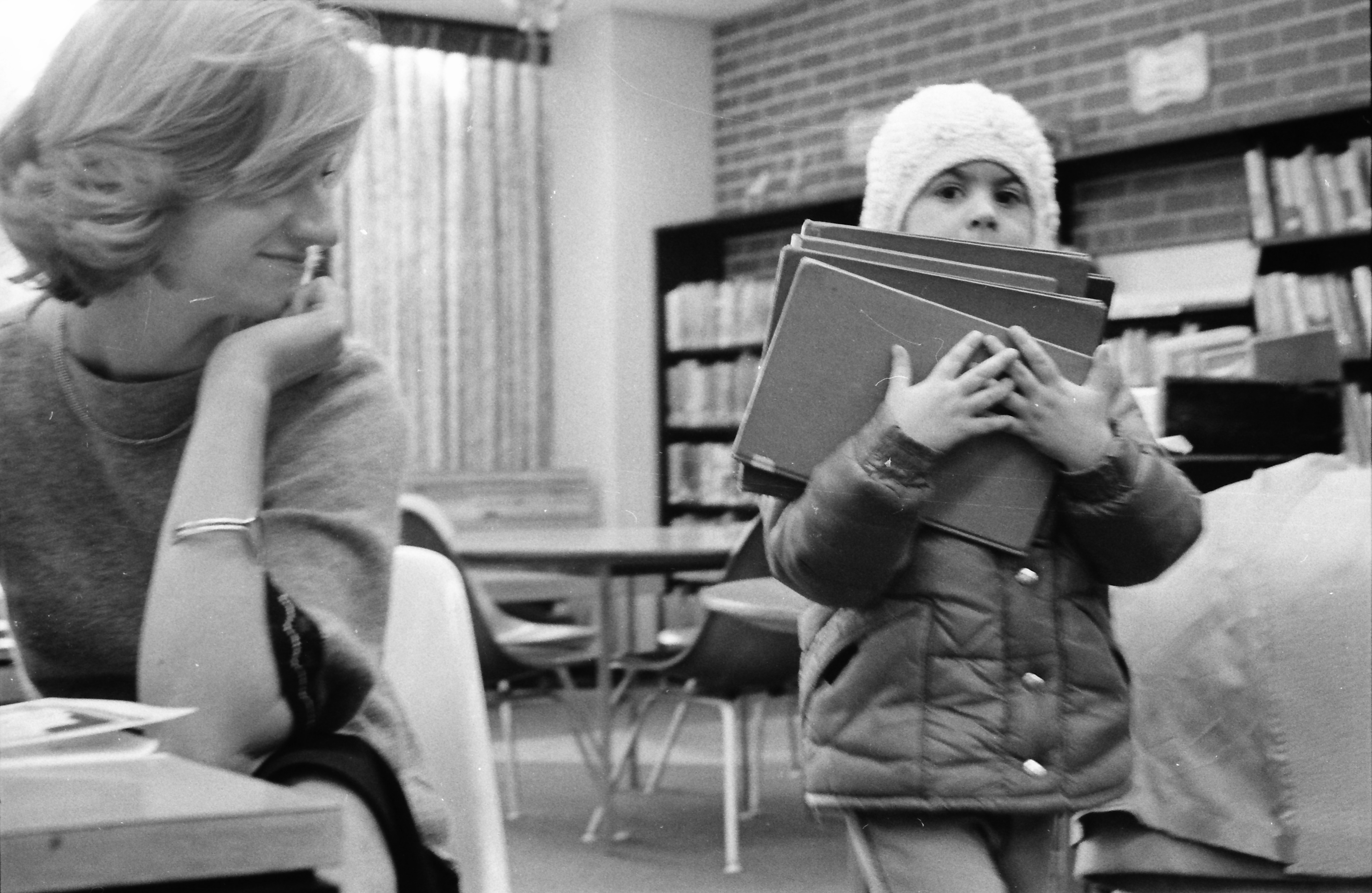 Kara More Taking Home a Big Stack of Books, Ann Arbor Public Library, March 1977 image