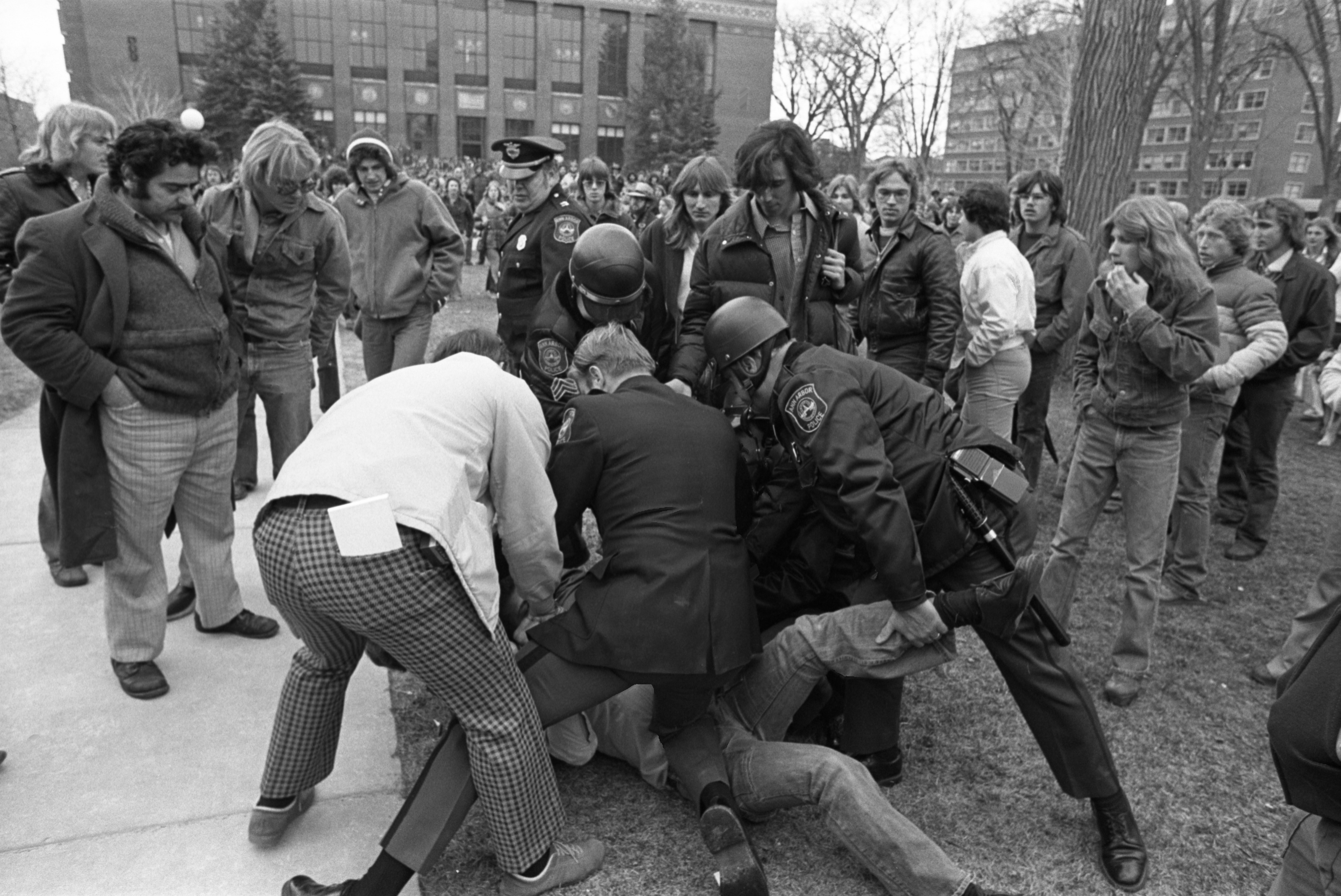 Police Scuffle With Hash Bash Attendee On Diag, April 2, 1977 image