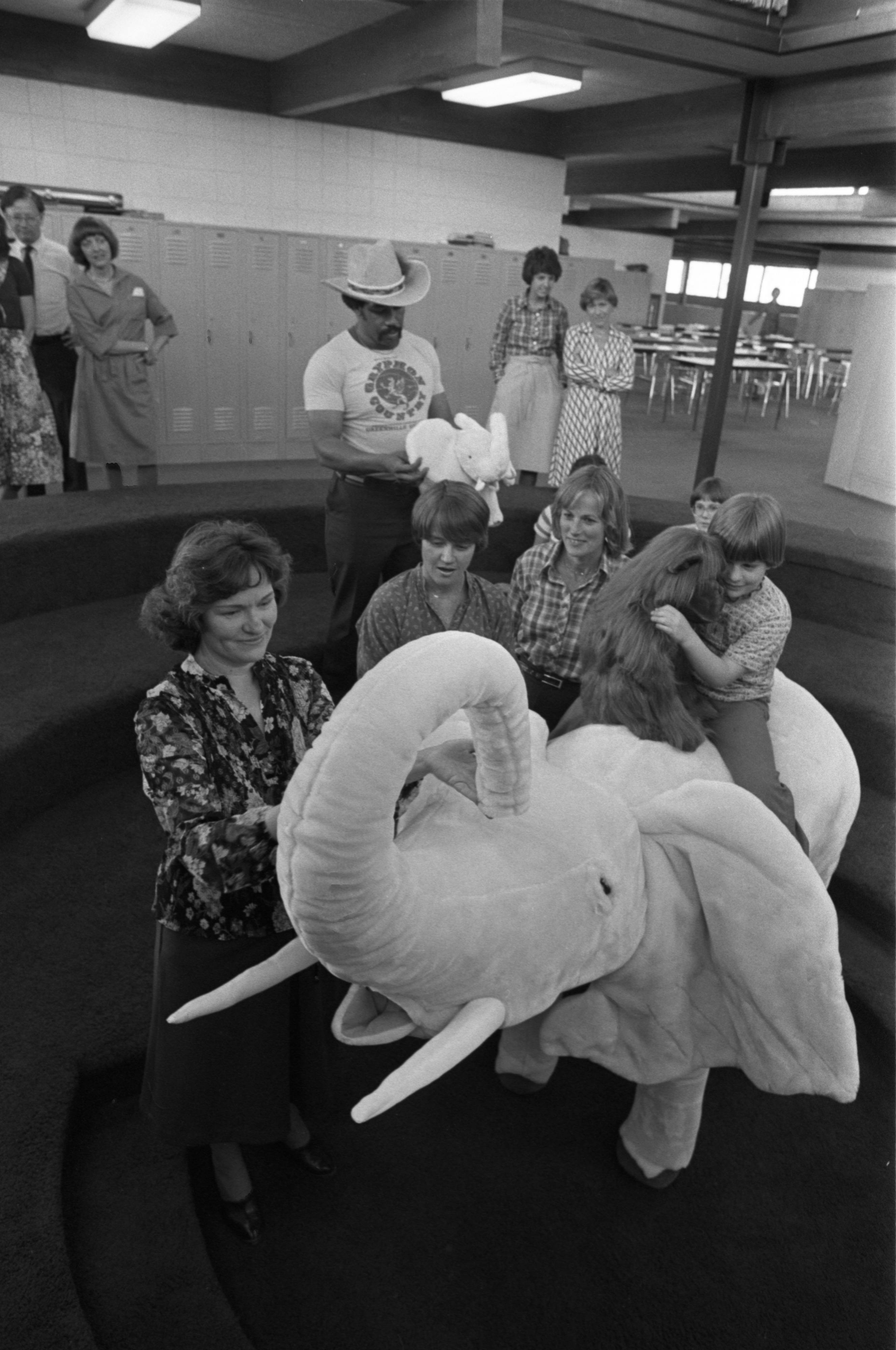 Ira Jensen Shows Others The Stuffed Elephant She Made For The Annual Spring Gala At Greenhills, May 9, 1979 image