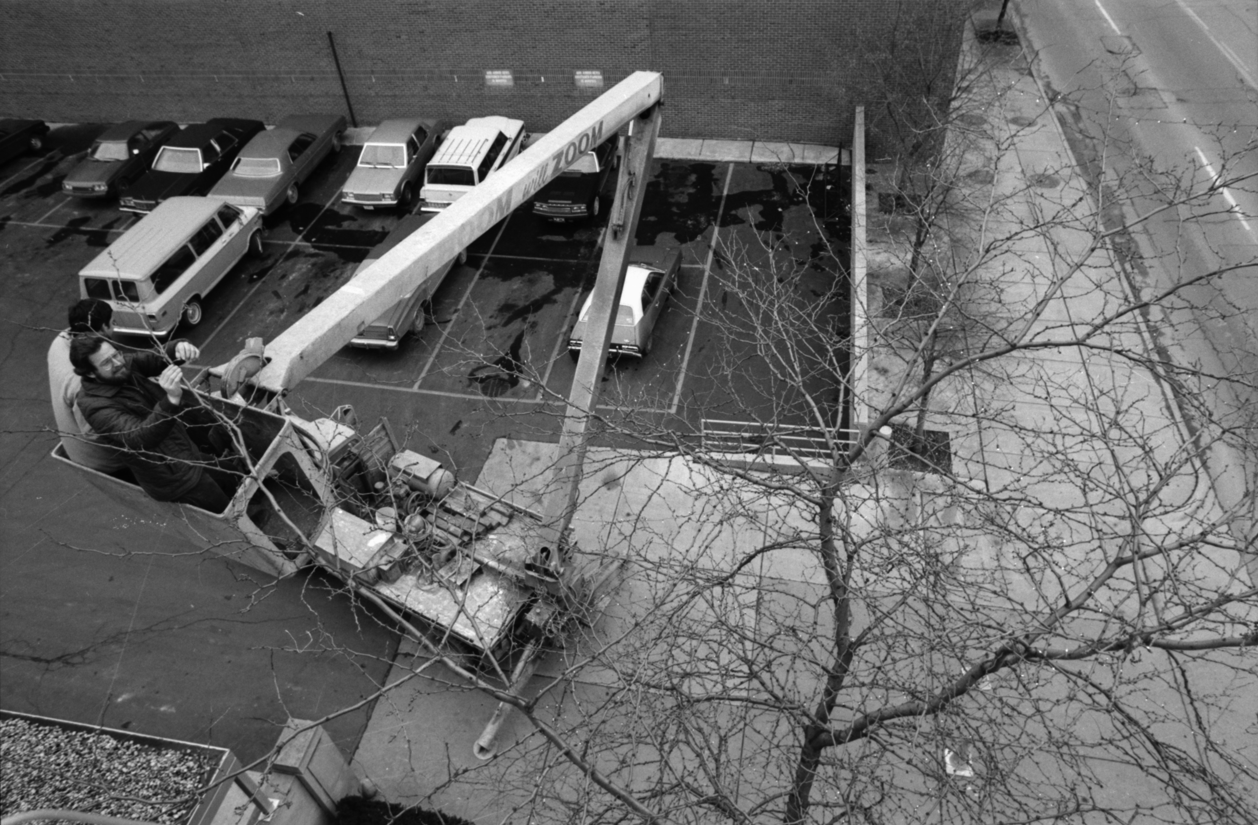 Putting up Christmas lights at the Ann Arbor News, December 1981 image
