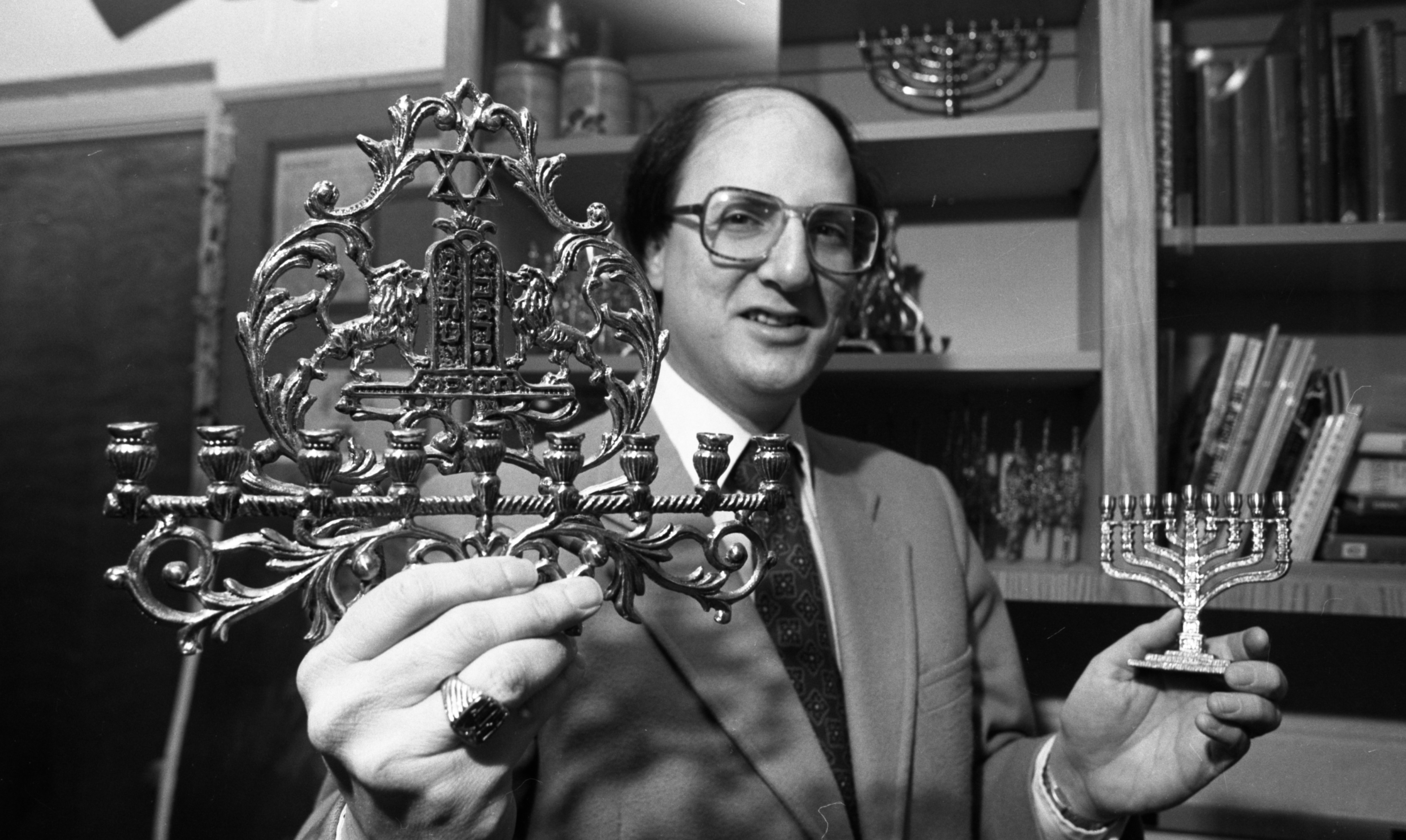 Rabbi Ralph Mecklenburger of Temple Beth Emeth Holding Menorahs Sold At Their Gift Shop, December 1981 image