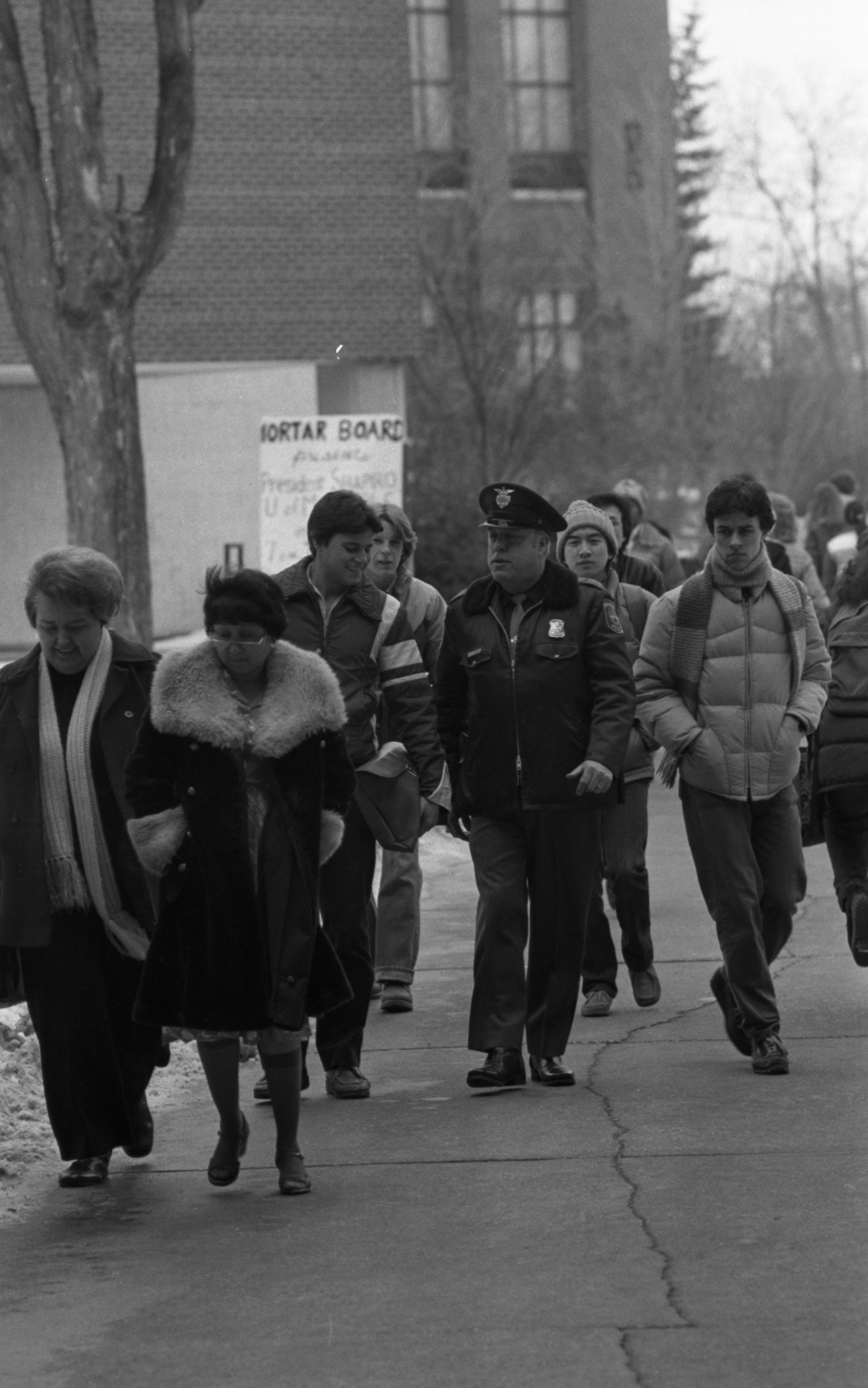 Ann Arbor Police Officer Charles V. Fleming Walks His Last Beat Across University of Michigan Campus, January 1981 image