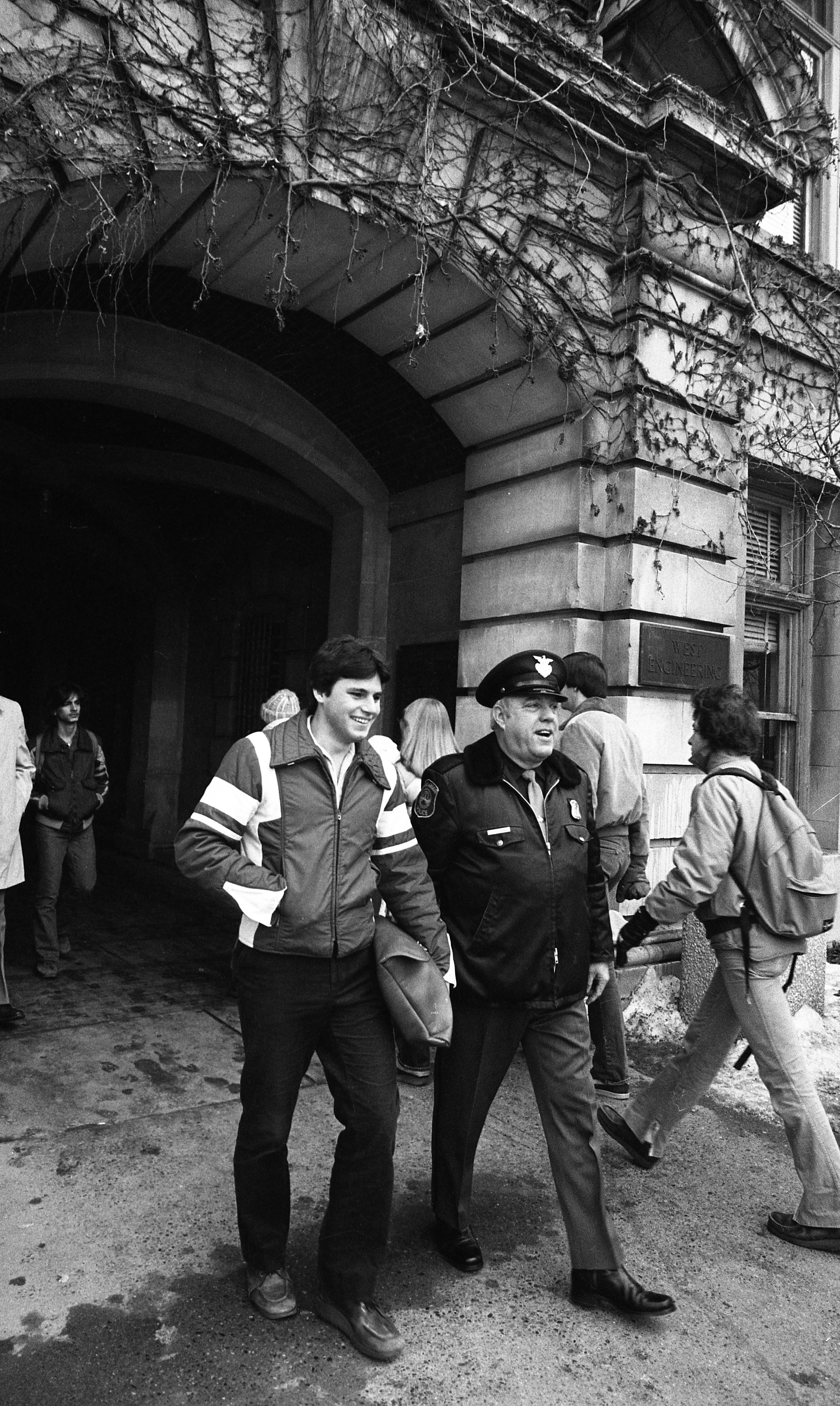 Ann Arbor Police Officer Charles V. Fleming Walks & Talks With University of Michigan Students, January 1981 image